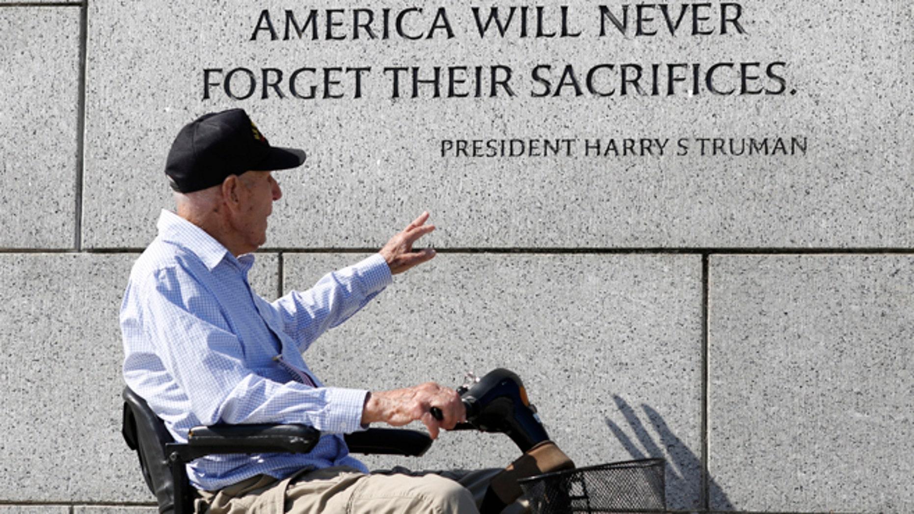 A World War Two veteran tours the World War Two Memorial in Washington.