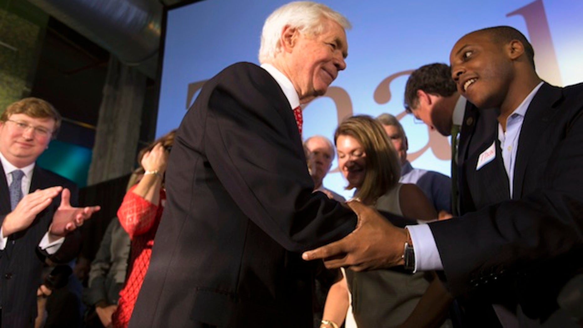 Republican U.S. Senator Thad Cochran greets supporter Marcus Ward (R) during an election night celebration after defeating Tea Party challenger Chris McDaniel in a run-off election in Jackson, Mississippi June 24, 2014. REUTERS/Lee Celano  (UNITED STATES - Tags: POLITICS ELECTIONS) - RTR3VLJF