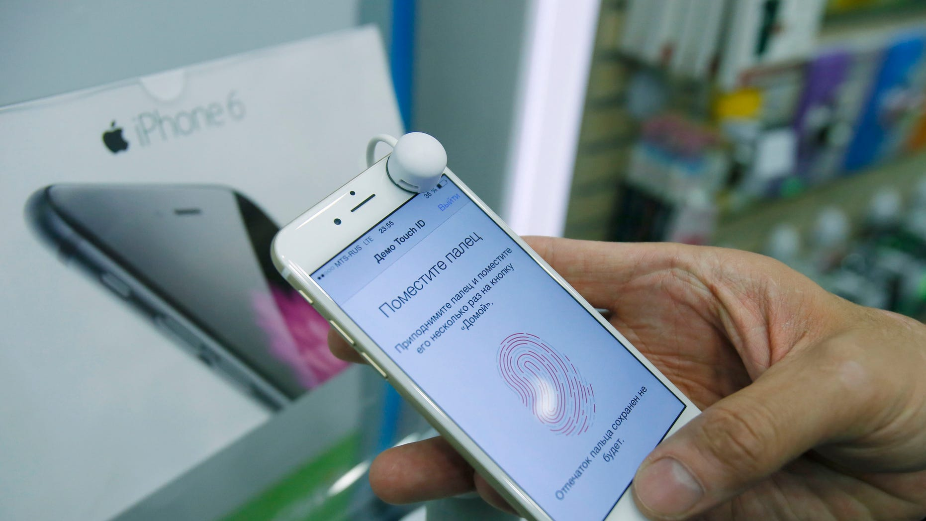 A man holds an iPhone 6 in a mobile phone shop in Moscow.