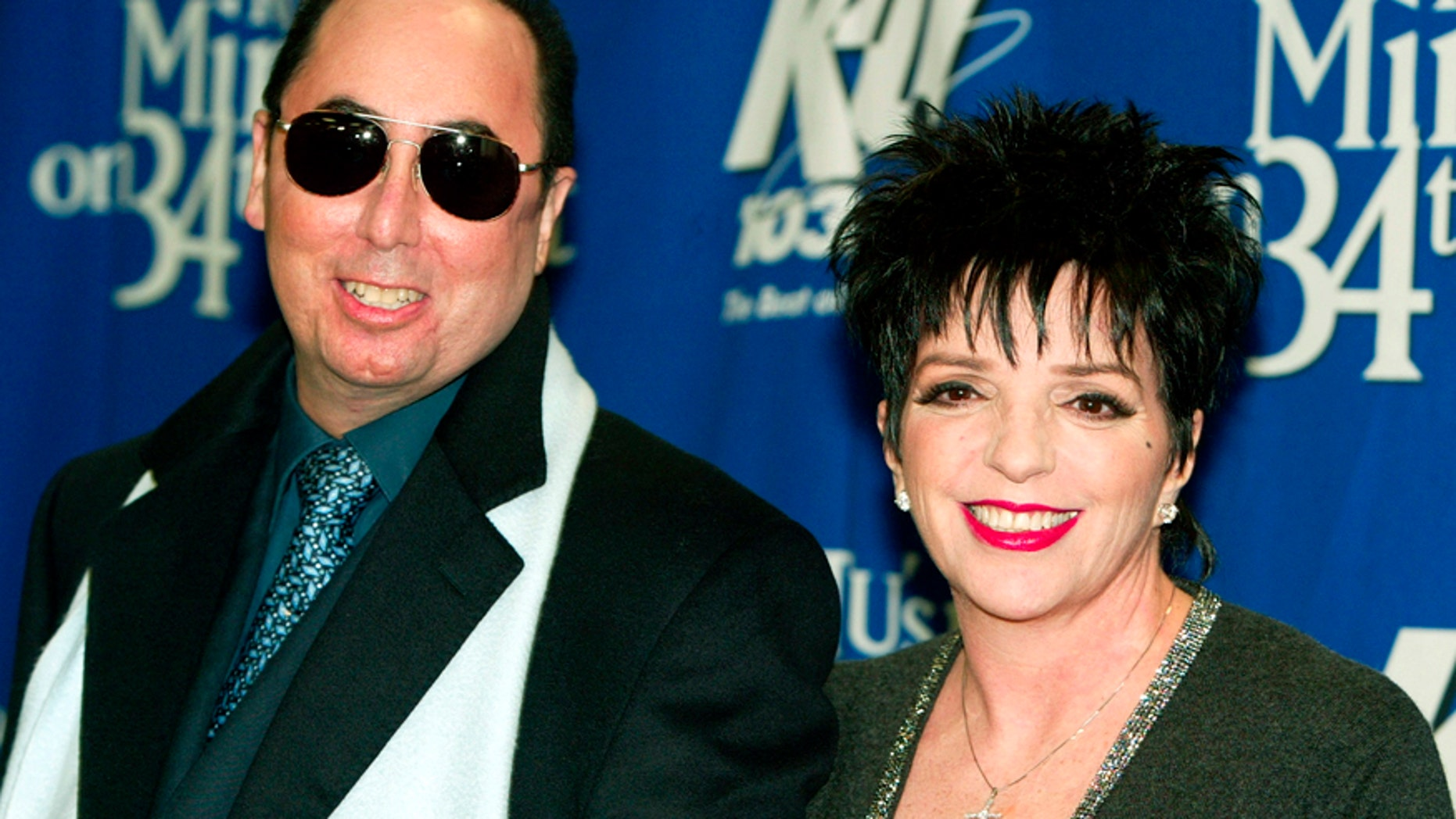 """Singer Liza Minnelli and her husband David Gest pose for photographers backstage of the """"Miracle on 34th Street"""" concert hosted by radio station WKTU in New York City, December 18, 2002."""