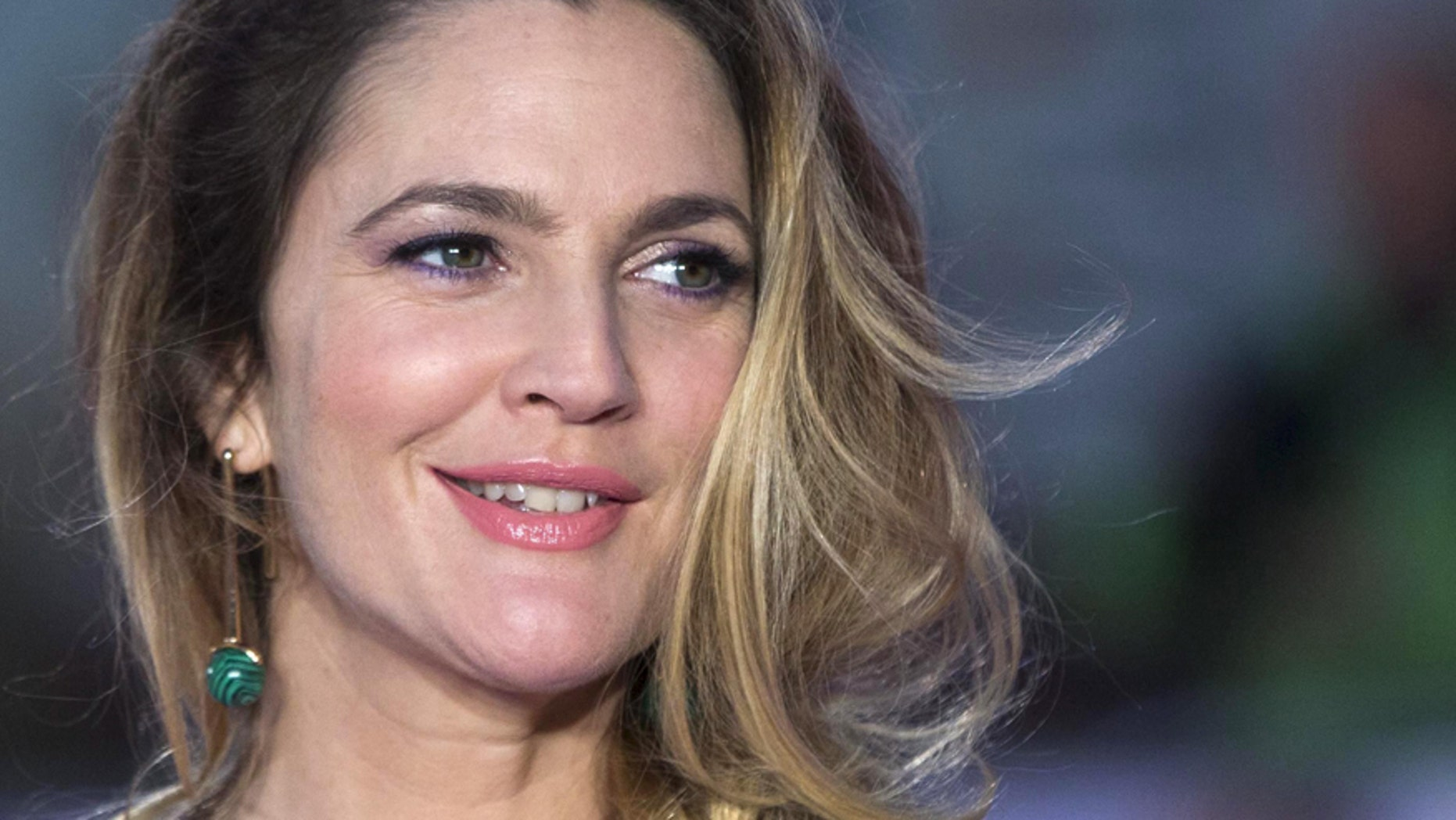 """U.S. actress Drew Barrymore poses for photographers at the European premiere of the film """"Miss You Already"""" in London September 17, 2015."""