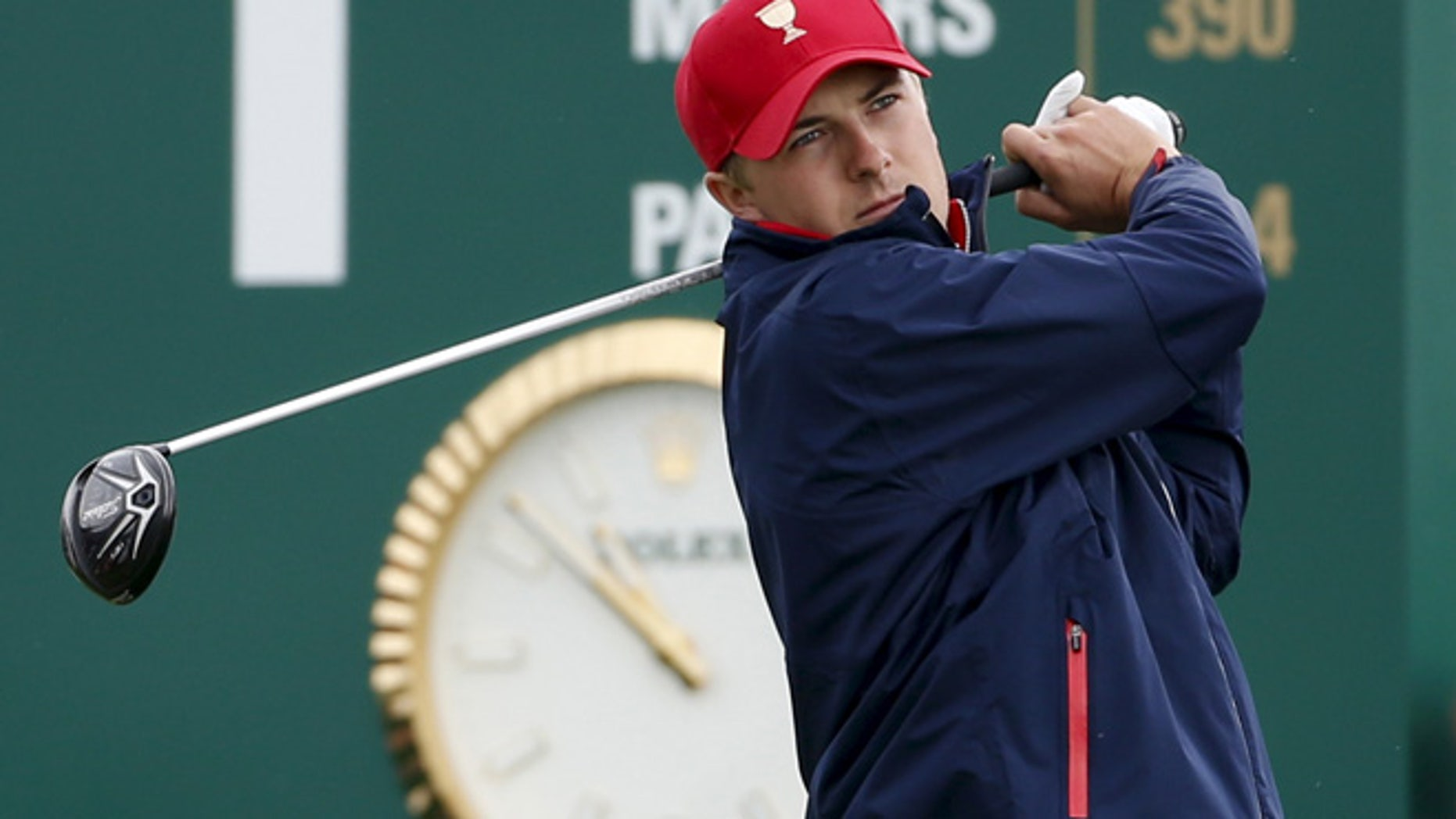 Oct. 11, 2015: U.S. team member Jordan Spieth tees off on the first hole during their singles matches of the 2015 Presidents Cup golf tournament.
