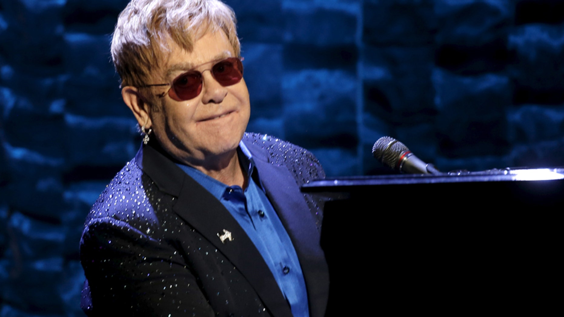 "Singer Elton John performs at the Hillary Victory Fund ""I'm With Her"" benefit concert for U.S. Democratic presidential candidate Hillary Clinton at Radio City Music Hall in the Manhattan borough of New York City, March 2, 2016."