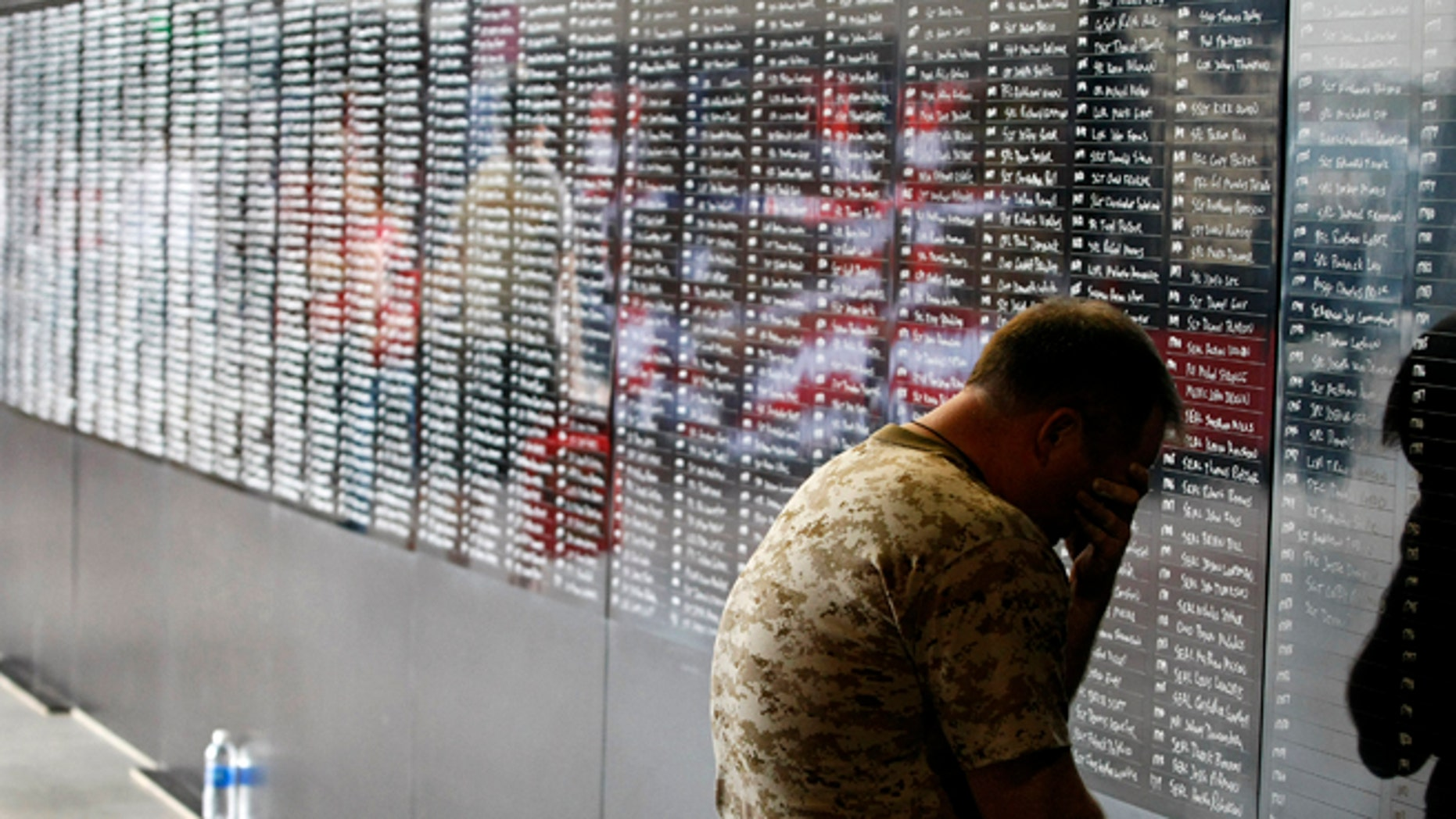 Two-time Memory Champion and U.S. Navy veteran Ron White pauses to reflect for a moment as he adds the names of over 2,000 fallen military personnel who served in the war in Afghanistan.