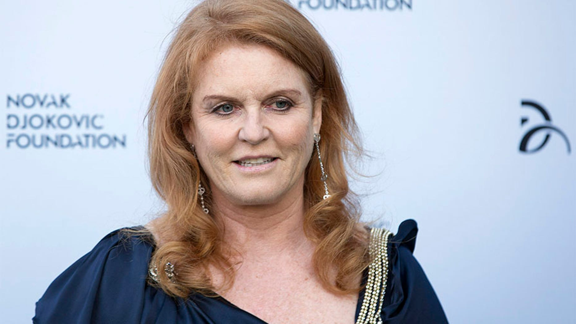 Britain's Sarah Ferguson, the Duchess of York, poses for photographers as she arrives at a fundraising dinner for the Novak Djokovic Foundation in London July 8, 2013.   REUTERS/Neil Hall   (BRITAIN - Tags: SPORT TENNIS ENTERTAINMENT SOCIETY PROFILE HEADSHOT ROYALS) - GM1E9790CWB01