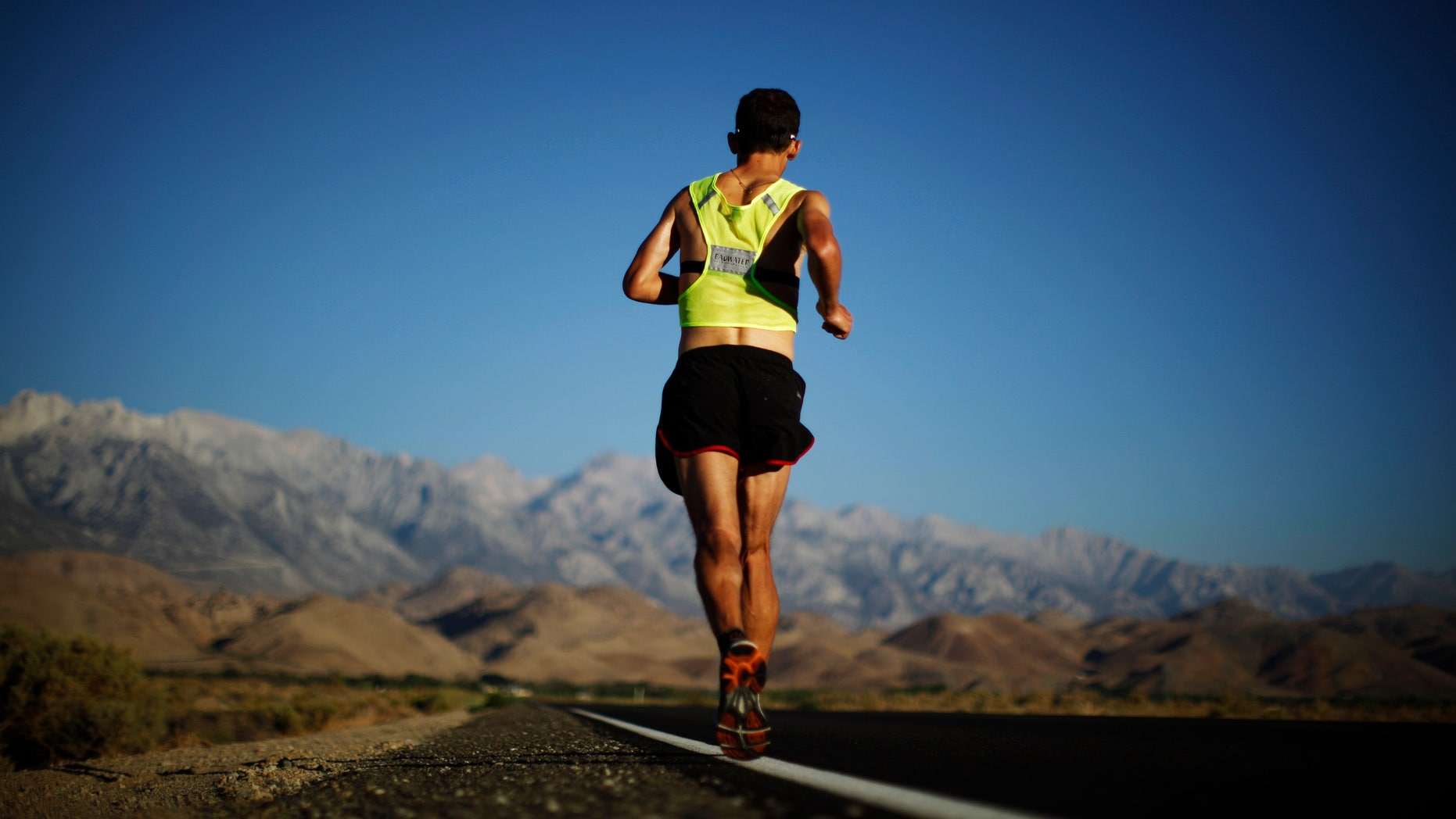 Carlos Alberto Gomes De Sa of Portugal runs on his way to winning the Badwater Ultramarathon on July 16, 2013. The 135-mile race goes from Death Valley to Mount Whitney, California in temperatures which can reach 130 degrees Fahrenheit.  (REUTERS/Lucy Nicholson)