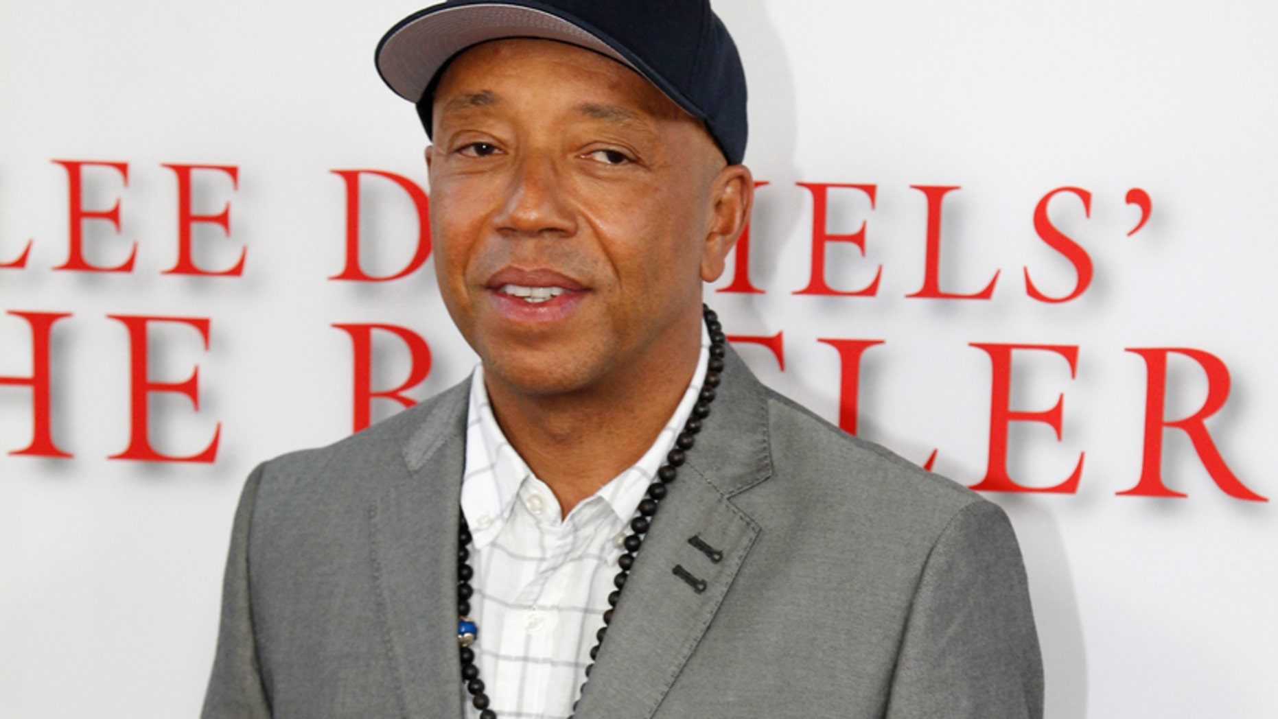 """Russell Simmons arrives as a guest to the premiere of the new film """"Lee Daniels' The Butler"""" in Los Angeles, California August 12, 2013."""