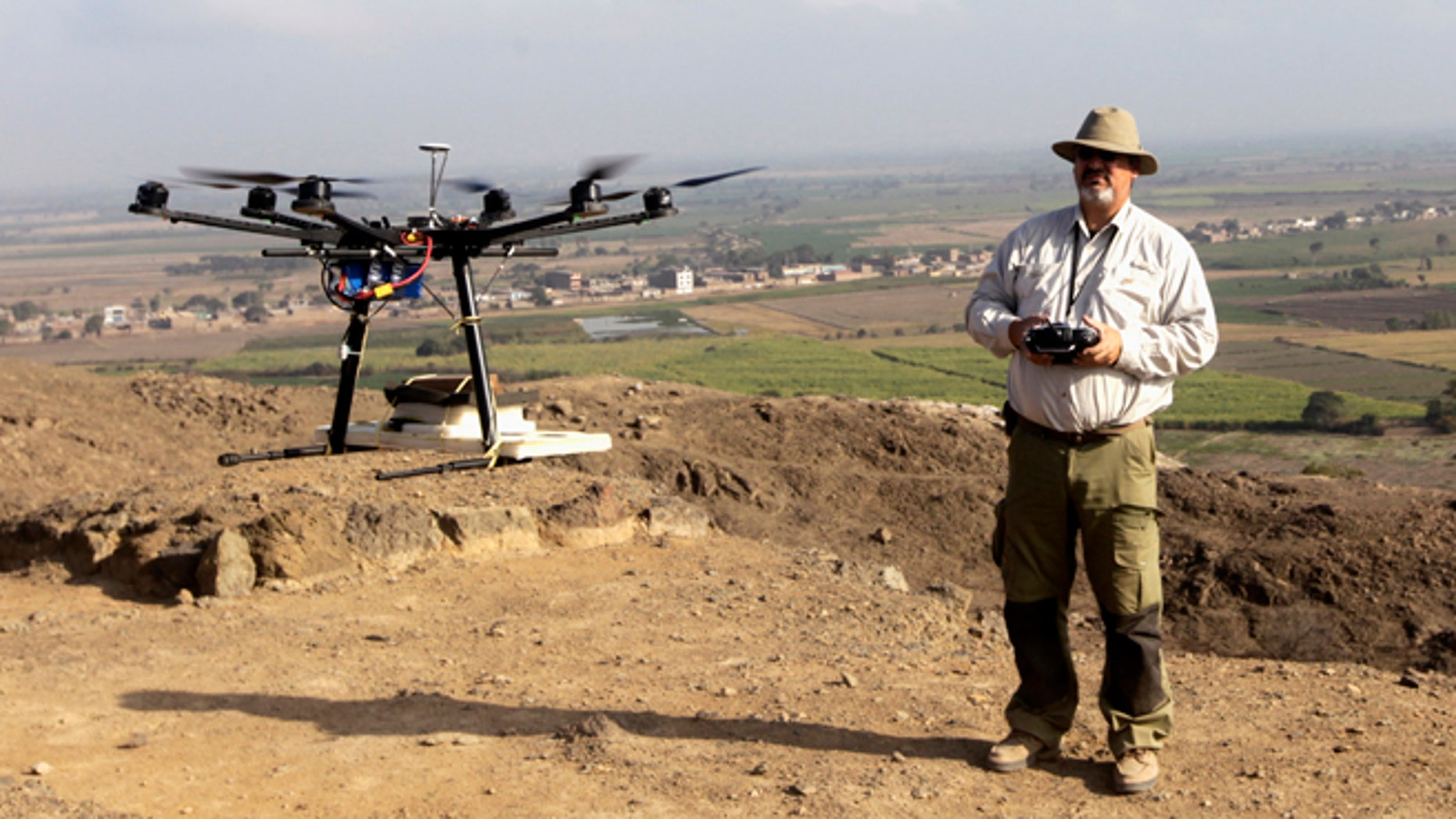 Luis Jaime Castillo, a Peruvian archaeologist with Lima's Catholic University and an incoming deputy culture minister, flies a drone over the archaeological site of Cerro Chepen in Trujillo August 3, 2013.