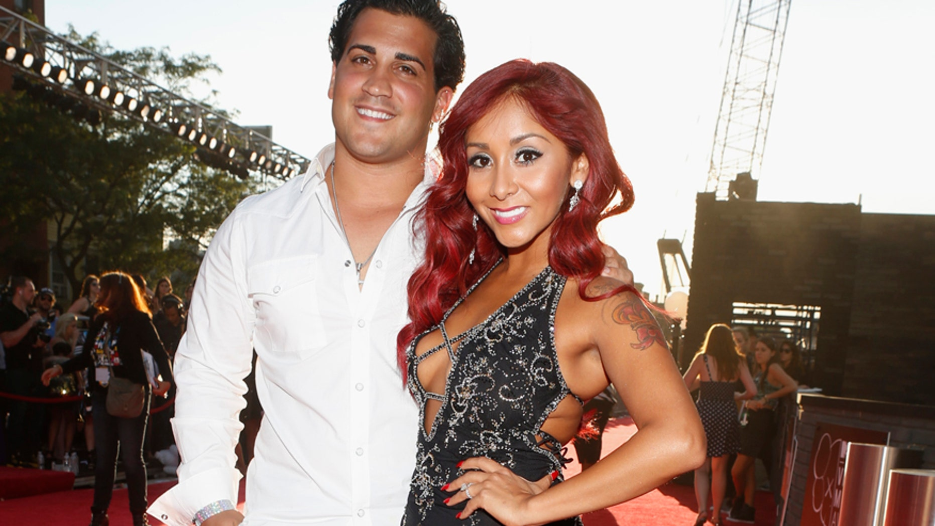 """Jionni LaValle and Nicole """"Snooki"""" Polizzi arrive for the 2013 MTV Video Music Awards in New York August 25, 2013."""