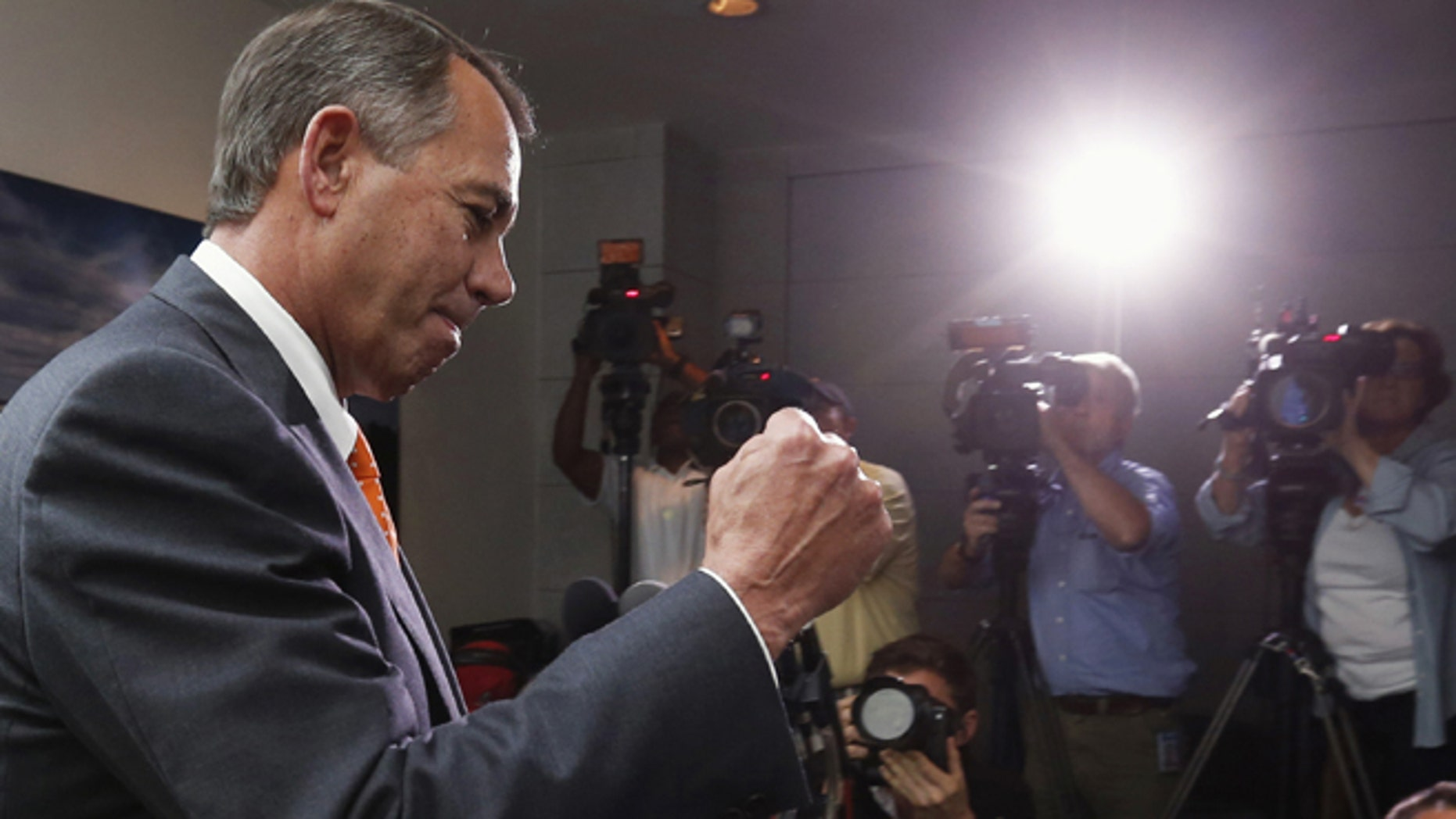 Speaker of the House John Boehner pumps his fist as he emerges from a meeting with Republican House members  in the U.S. Capitol in Washington October 16, 2013.