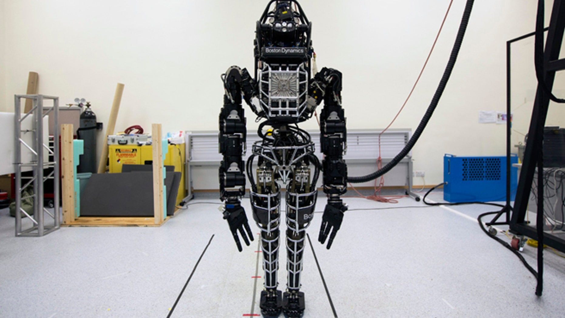 """Bipedal humanoid robot """"Atlas"""", primarily developed by the American robotics company Boston Dynamics, is presented to the media during a news conference at the University of Hong Kong October 17, 2013. Google recently acquired the company."""