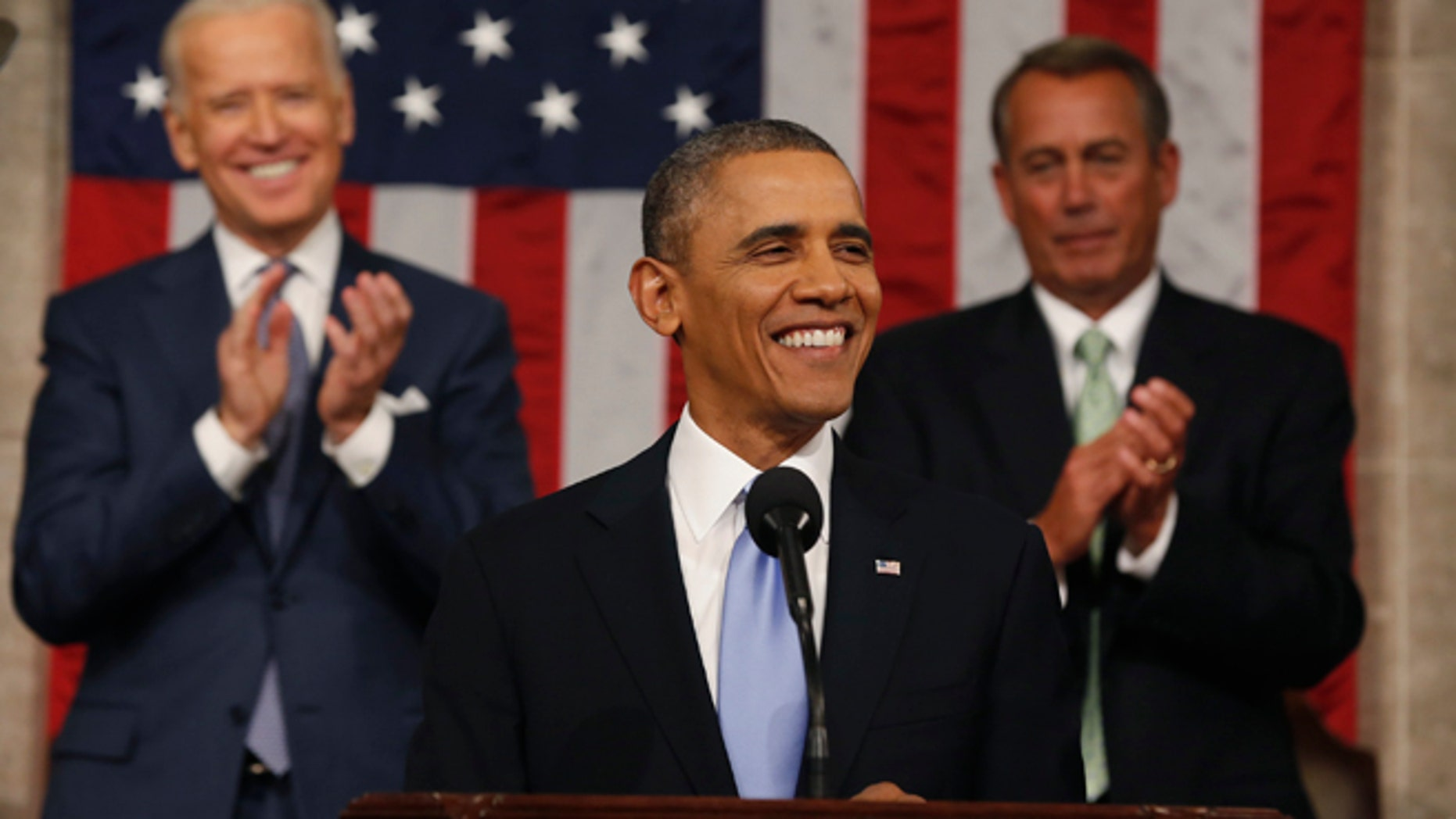 Vice President Joe Biden (L) and Speaker of the House John Boehner applaud as President Barack Obama finishes his State of the Union speech on Capitol Hill in Washington, January 28, 2014.
