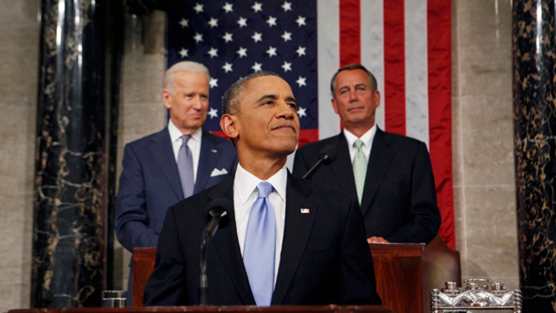 U.S. President Barack Obama smiles as he arrives to deliver his State of the Union speech on Capitol Hill in Washington January 28, 2014.