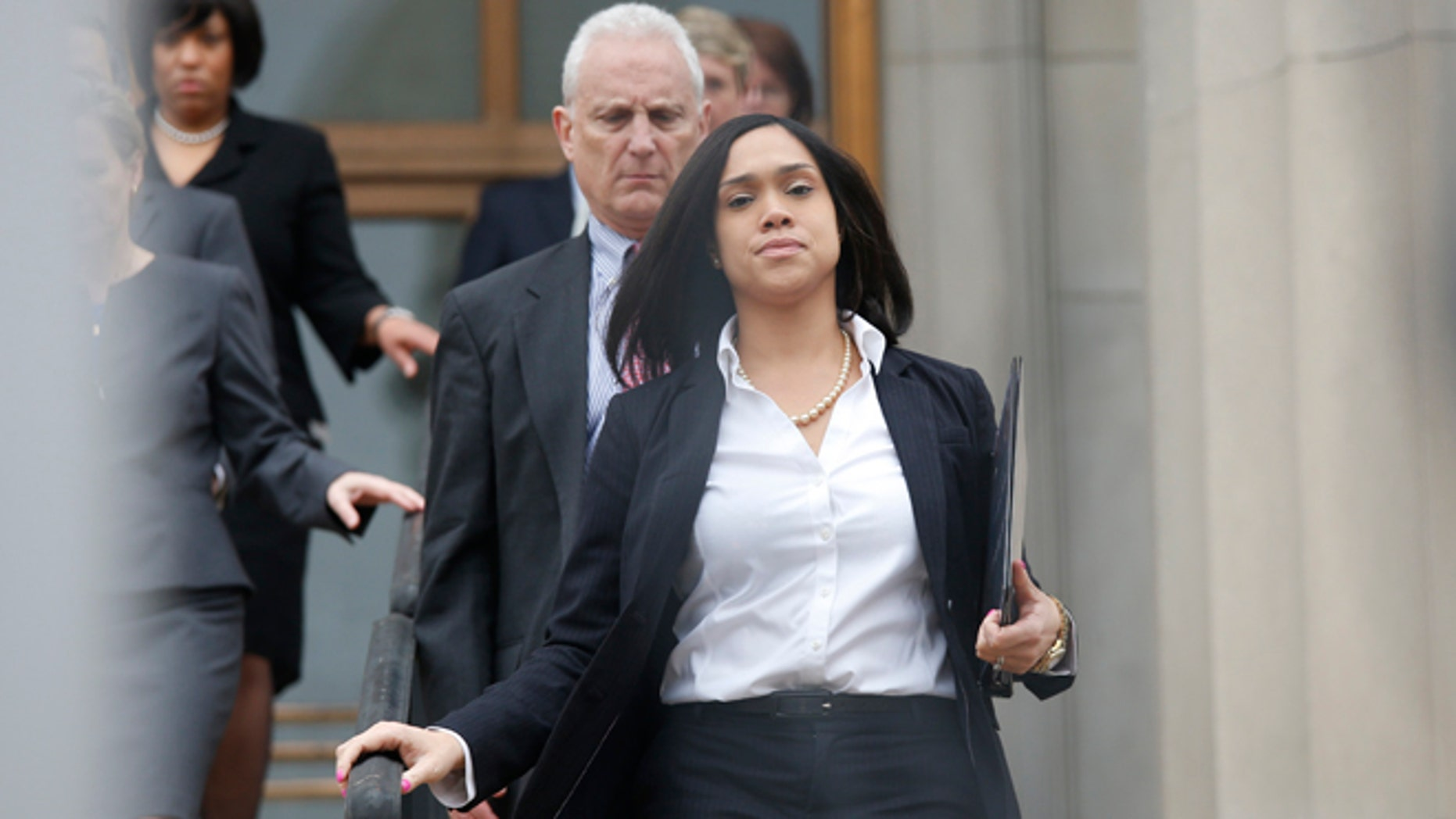 May 1, 2015: Baltimore state attorney Marilyn Mosby walks down the stairs followed by her legal team to speak on Freddie Gray case.