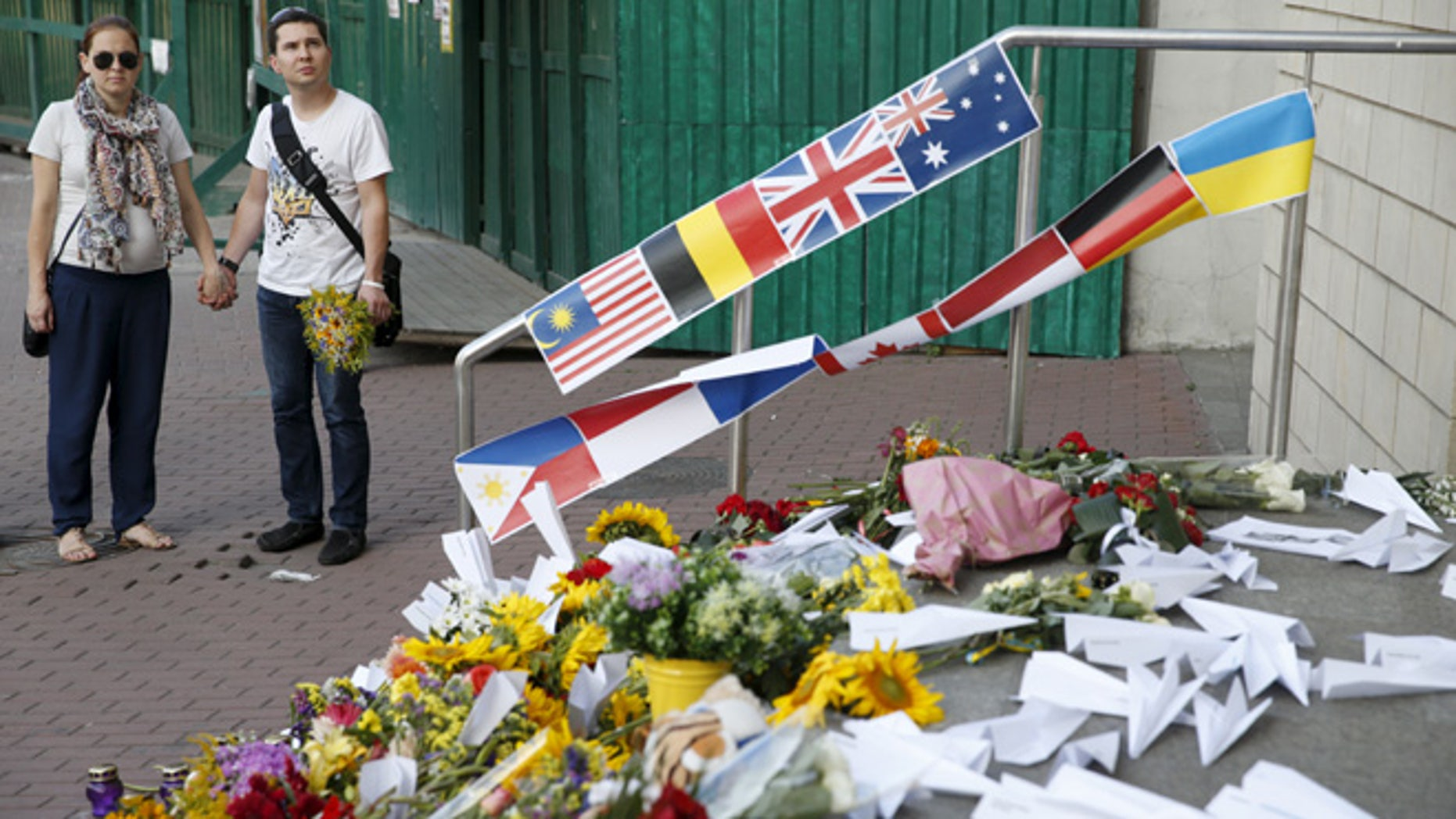 July 17, 2015: People gather outside the Dutch embassy to commemorate the victims of the Malaysia Airlines flight MH17 plane crash in 2014 in Kiev, Ukraine.