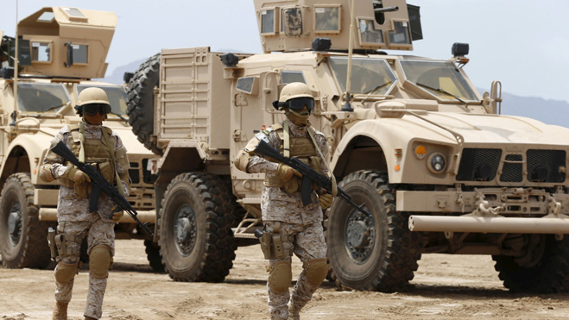 Sept. 28, 2015: Saudi troops walk at their base in Yemen's southern port city of Aden.