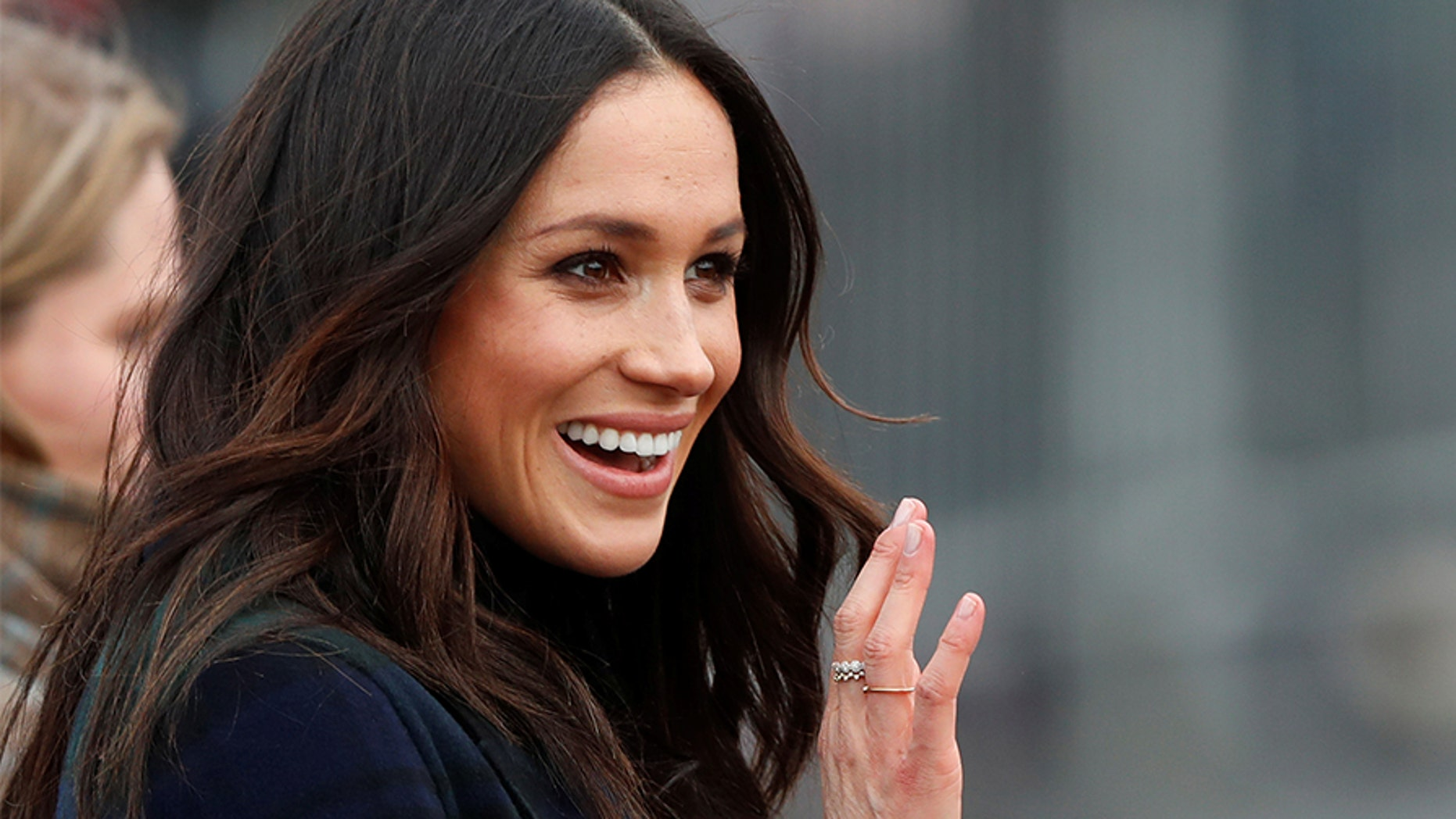 Meghan Markle, fiancee of Britain's Prince Harry, waves as she arrives for a visit to Edinburgh, Scotland February 13, 2018.