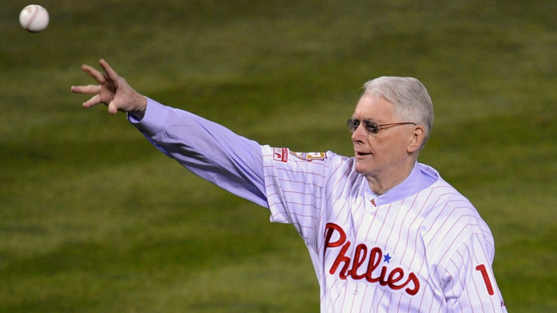 Former Philadelphia Phillies pitcher Jim Bunning throws out the ceremonial first pitch before Game 5 of Major League Baseball's World Series in Philadelphia, October 27, 2008.