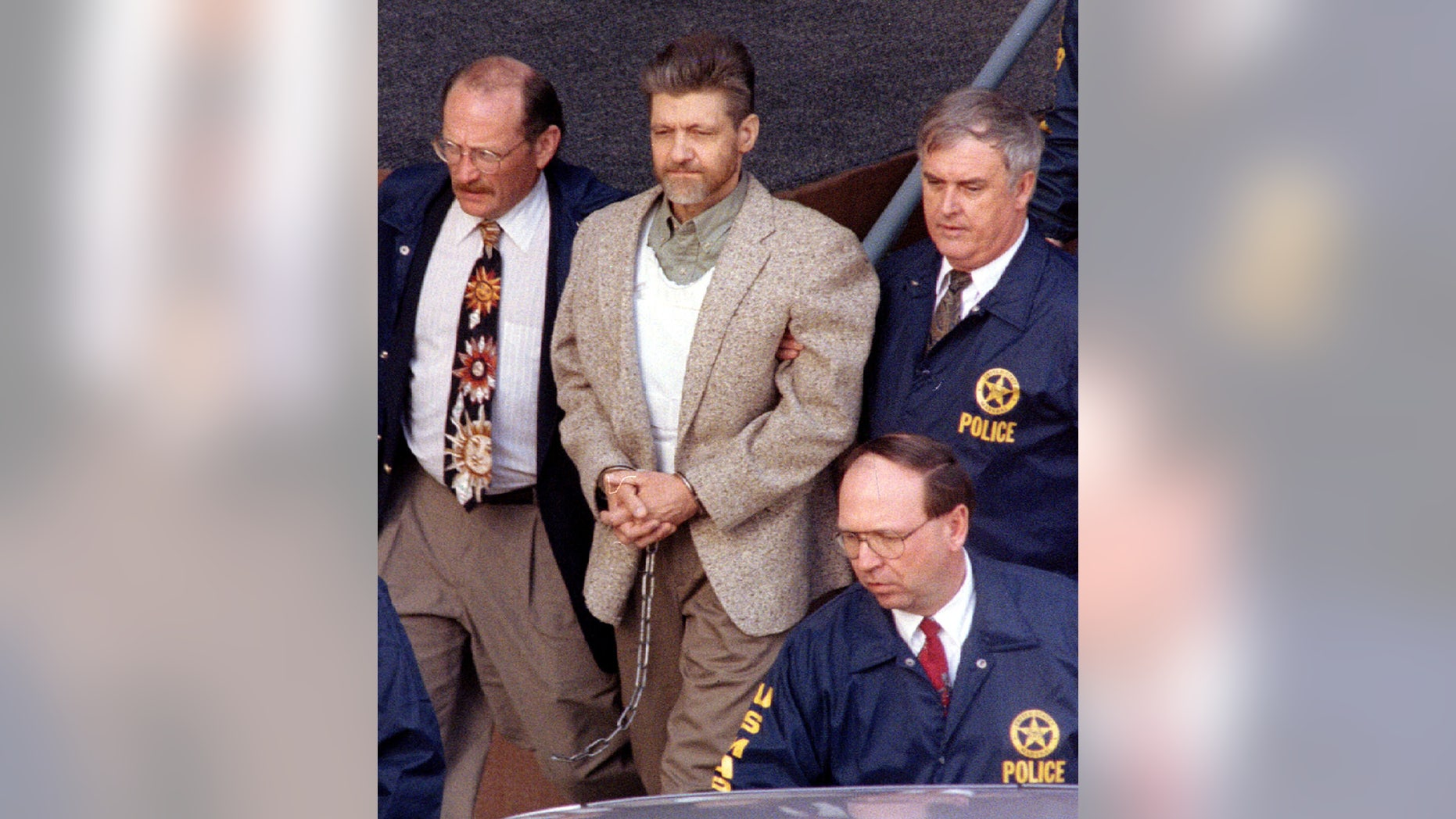 Unabomber suspect Ted Kaczynski is taken from the Helena federal courthouse by U.S. Marshals April 19. A federal judge denied Kaczynski's motion to dismiss the charges against him - RTXGTZC