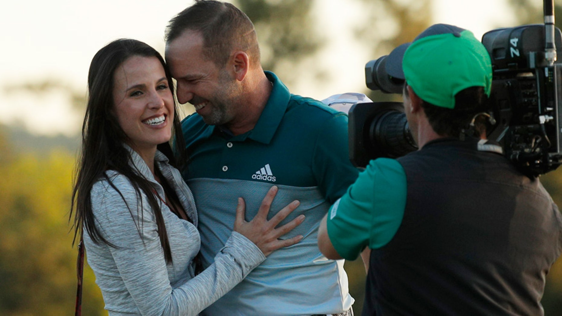 Sergio Garcia of Spain embraces Angela Akins after he won the 2017 Masters golf tournament in a playoff against Justin Rose of England at Augusta National Golf Club in Augusta, Georgia.