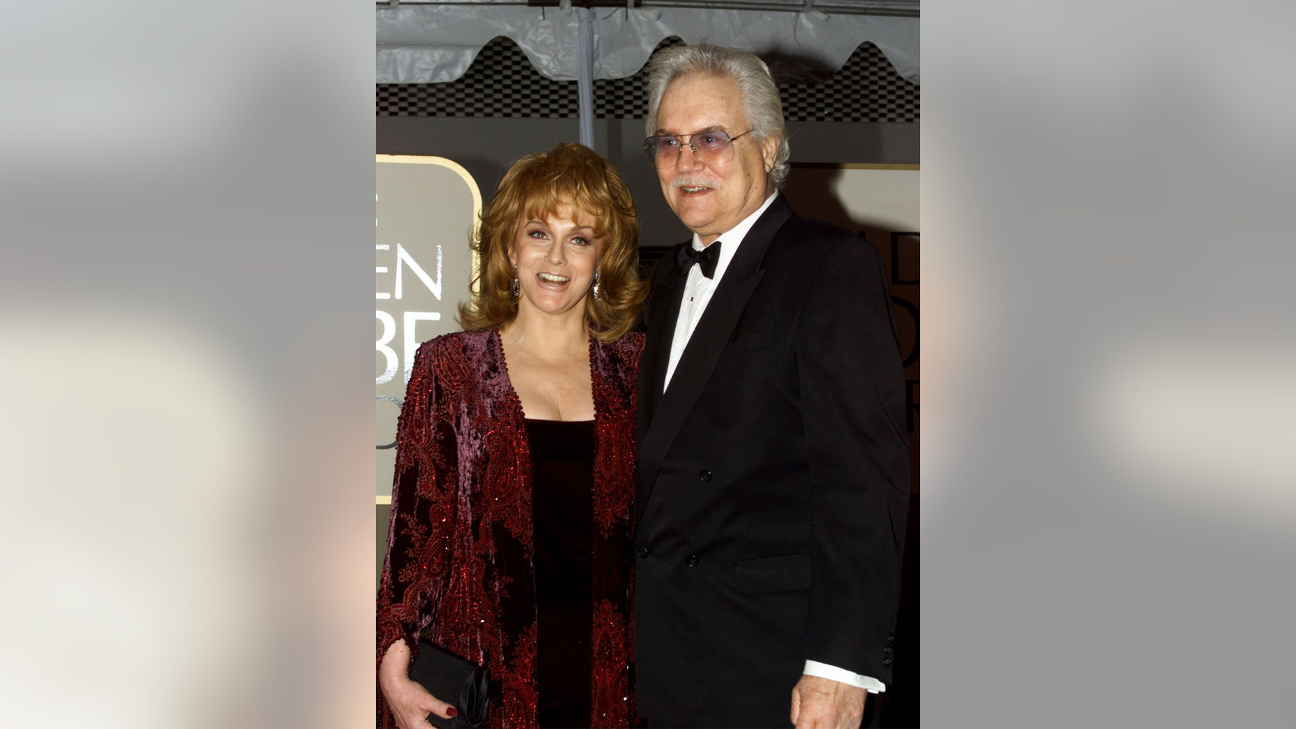 Actress Ann Margaret and her husband Roger Smith arrive at the 56th annual Golden Globe Awards ceremony in Beverly Hills, January 24, 1999.