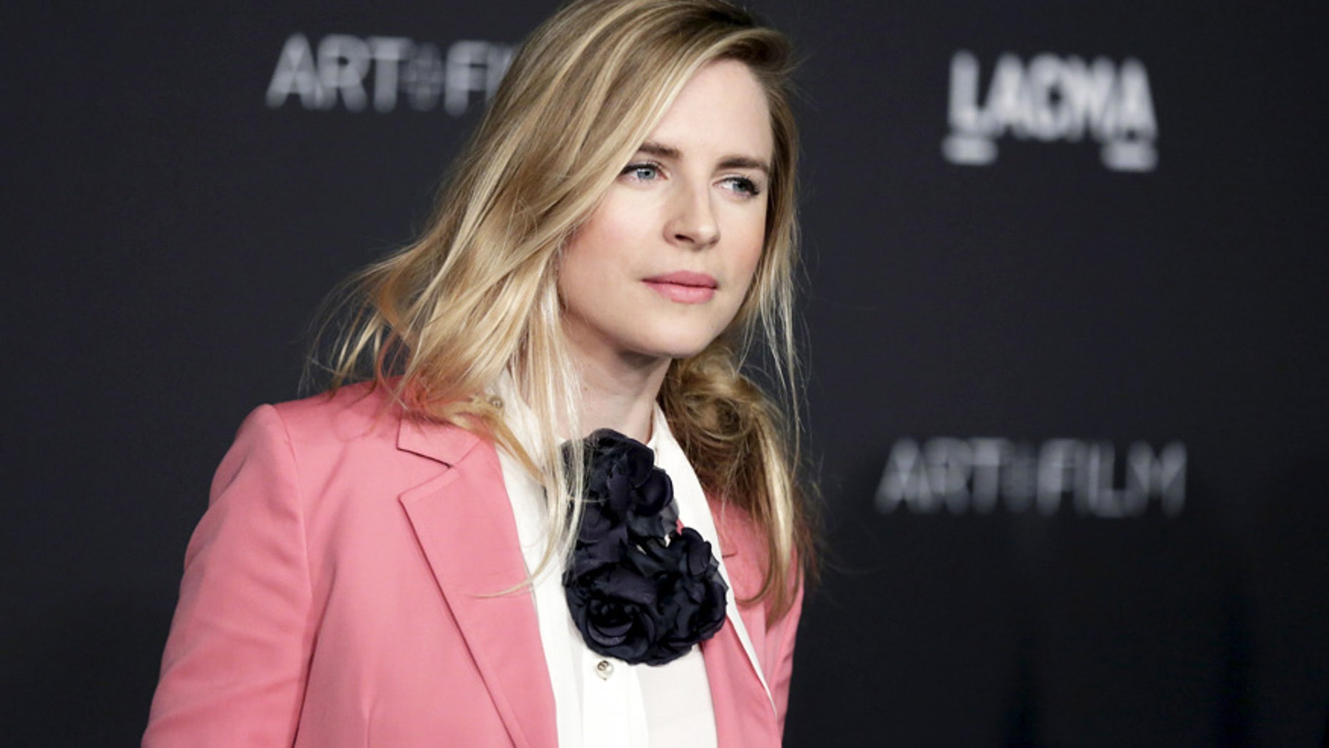 American actress and film producer Brit Marling is wearing a millennial pink-inspired suit, which is being hailed as one of the top fashion trends for spring.