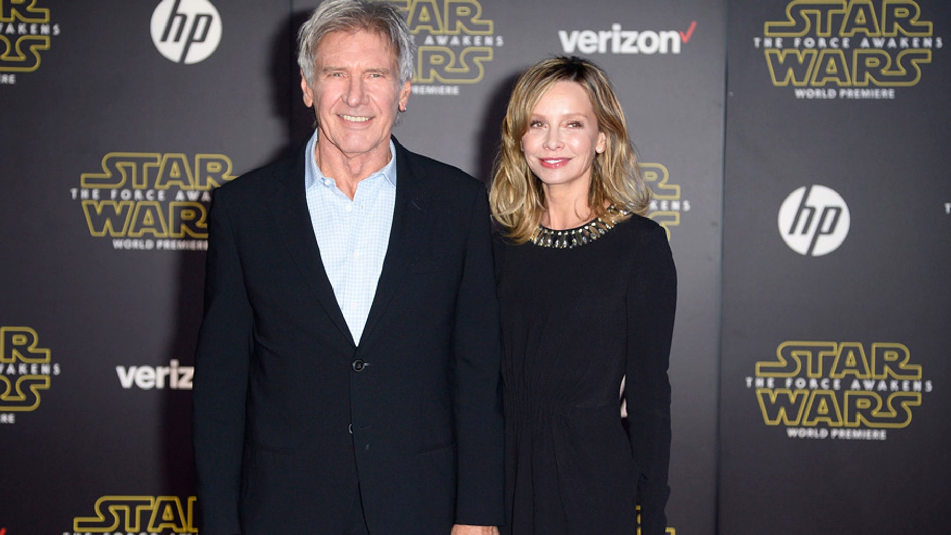 """Actor Harrison Ford and his wife, actress Calista Flockhart, arrive at the premiere of """"Star Wars: The Force Awakens"""" in Hollywood, California December 14, 2015."""