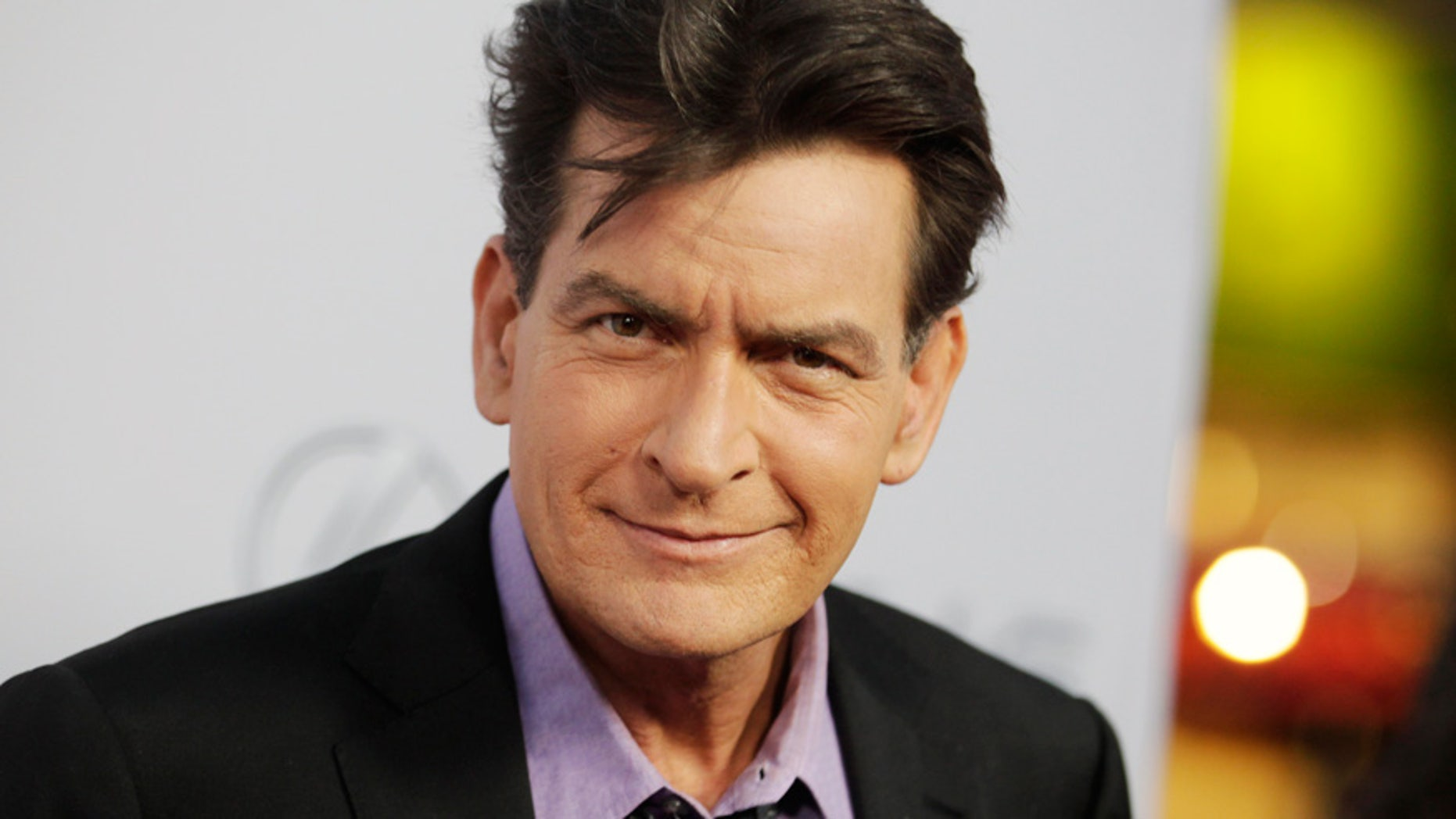 """Cast member Charlie Sheen poses at the premiere of his new film """"Scary Movie 5"""" in Hollywood April 11, 2013."""