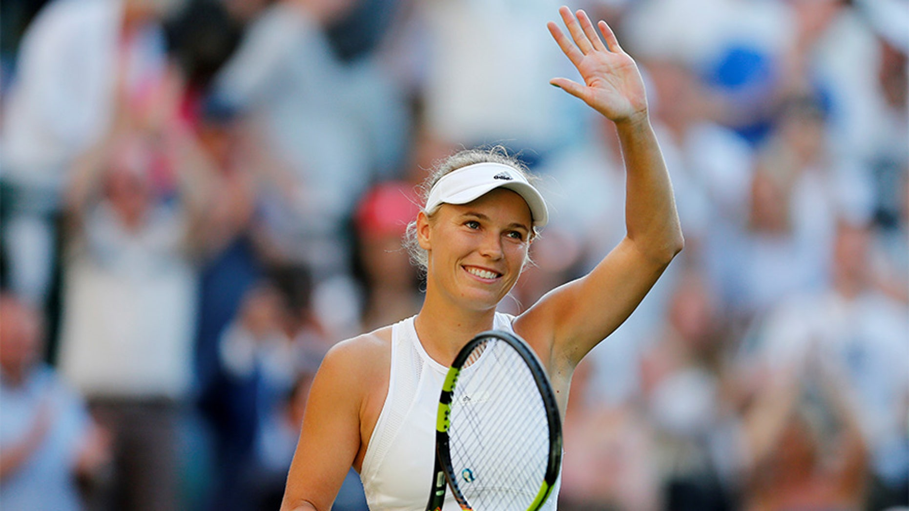 Denmark's Caroline Wozniacki celebrates winning the first round match against Hungary's Timea Babos.