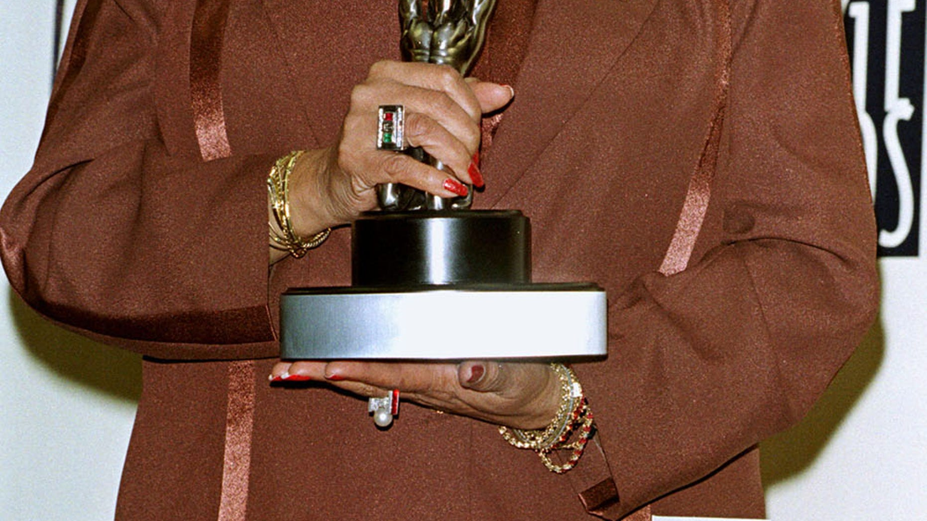"Actress Della Reese poses with the Image Award she received as Outstanding Actress in a Drama Television Series for her role in ""Touched by an Angel"" during the National Association  for the Advancement of Colored People's 29th annual Image Awards February 14 in Pasadena. The Image Awards, which will be telecast on the Fox television network on March 5, 1998, pay tribute to indivuduals that support positive change for African Americans in the entertainment industry. - PBEAHULZFBF"