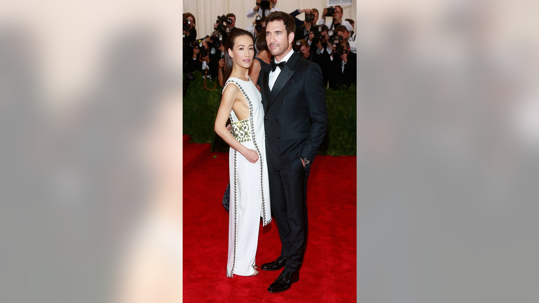"U.S. actors Dylan McDermott and Maggie Q arrive for the Metropolitan Museum of Art Costume Institute Gala 2015 celebrating the opening of ""China: Through the Looking Glass,"" in Manhattan, New York May 4, 2015.   REUTERS/Andrew Kelly - RTX1BK7G"