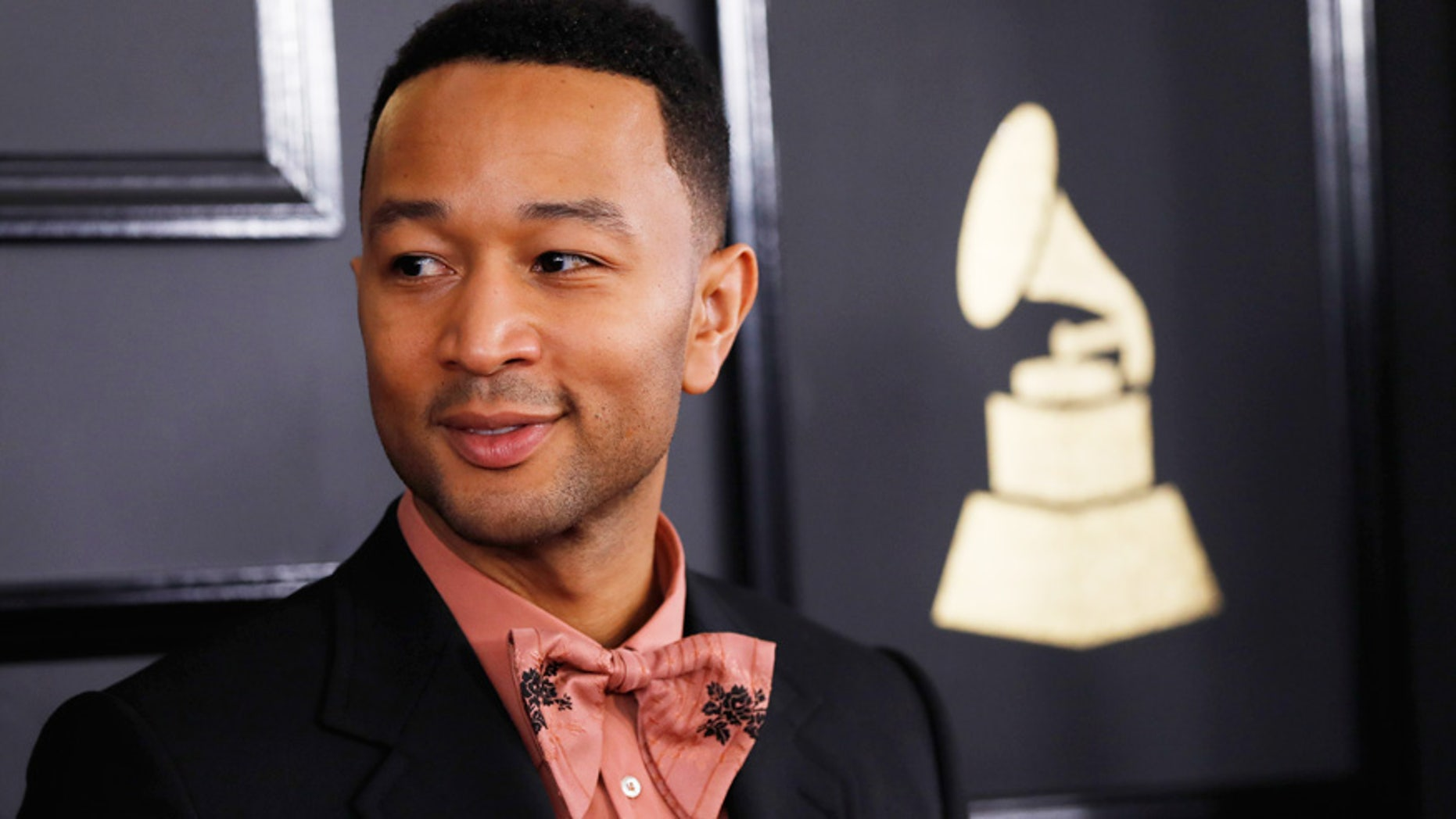John Legend opens up about life under Trump presidency and fatherhood. Here Legend poses for photos at the Grammy Awards in Los Angeles.