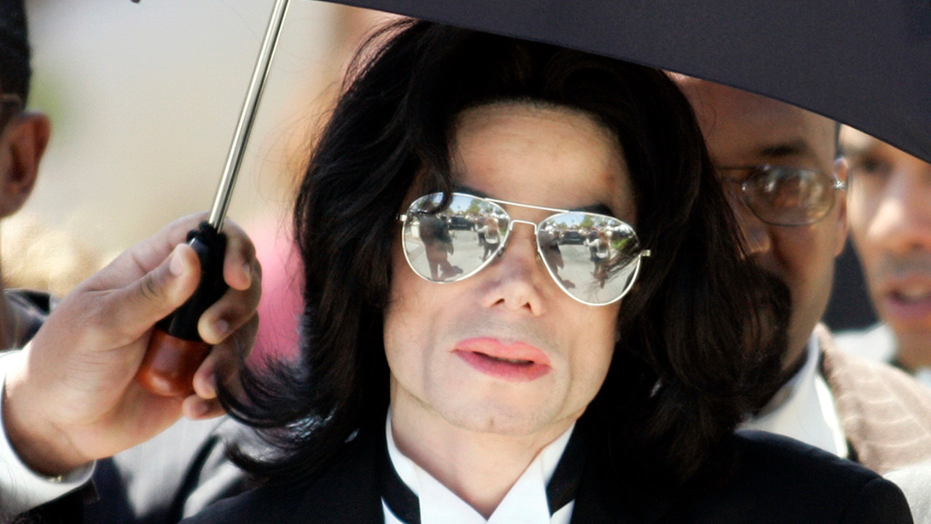 Michael Jackson leaves the Santa Barbara County Courthouse after being found not guilty on all ten counts of child molestation in Santa Maria, California in this June 13, 2005 file photo. Fans, museums and some members of Michael Jackson's family will mark Friday's one-year anniversary of the singer's death on June 25, 2010 with special exhibits, tributes and flash mob dances from Manila to Manhattan.  REUTERS/Gene Blevins/Files   (UNITED STATES - Tags: ENTERTAINMENT OBITUARY) - RTR2FLYL
