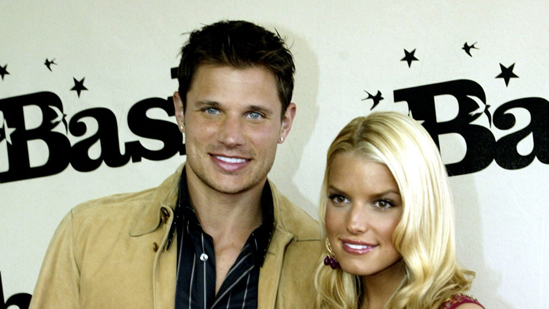"Nick Lachey and Jessica Simpson arrive for the MTV ""Bash,"" a night of comedy at the expense of MTV VJ Carson Daly in Hollywood."