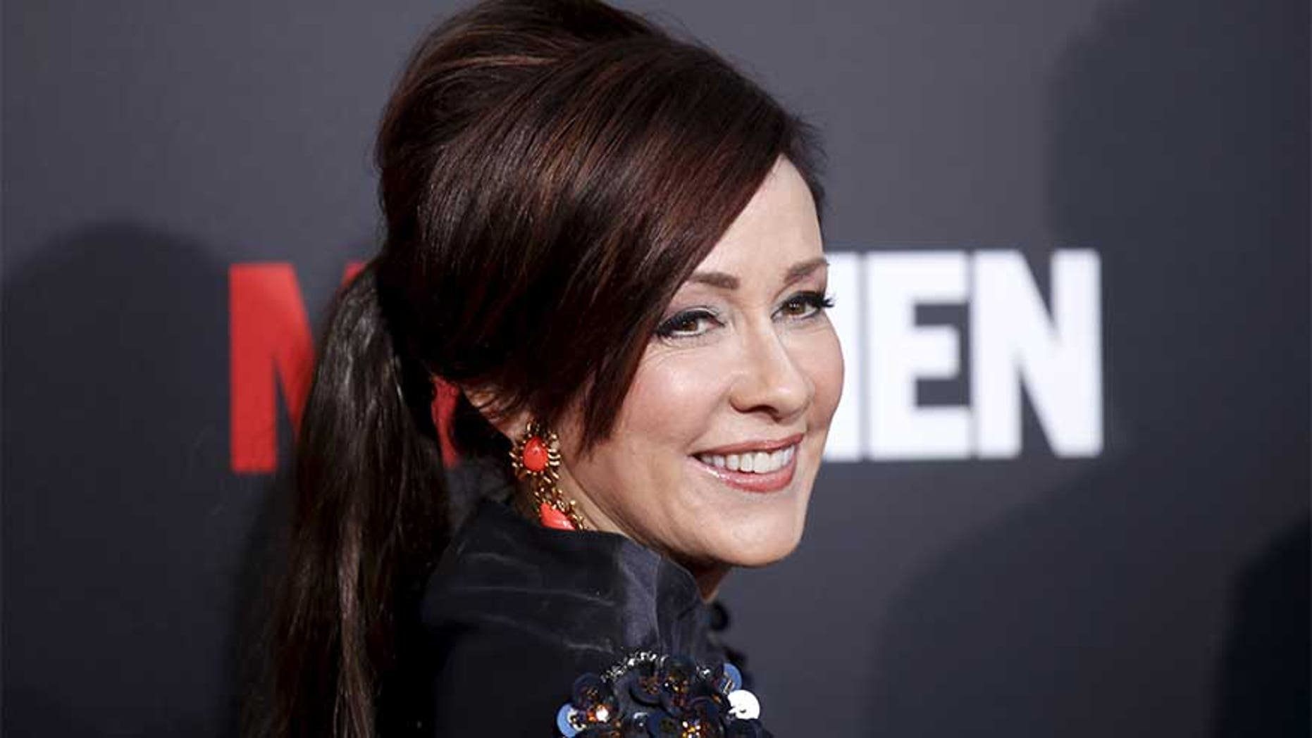 "Actress Patricia Heaton poses at the ""Mad Men"" Black and Red Ball to celebrate the final seven episodes of the AMC television series in Los Angeles Wednesday, March 25, 2015. REUTERS/Danny Moloshok - RTR4UWFR"