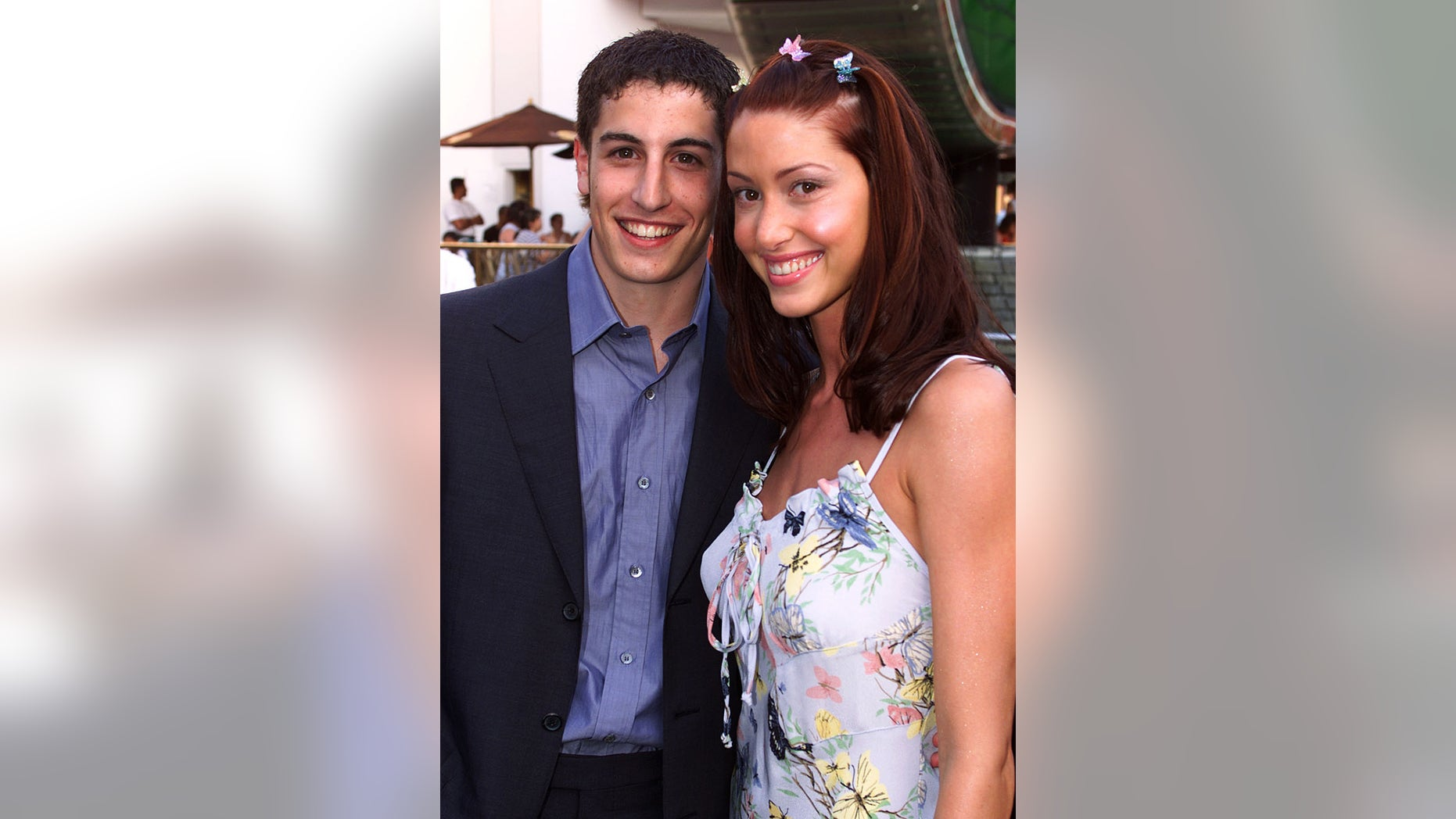 "Actors Jason Biggs (L) and Shannon Elizabeth, two of the ensemble cast members of the comedy film ""American Pie""."