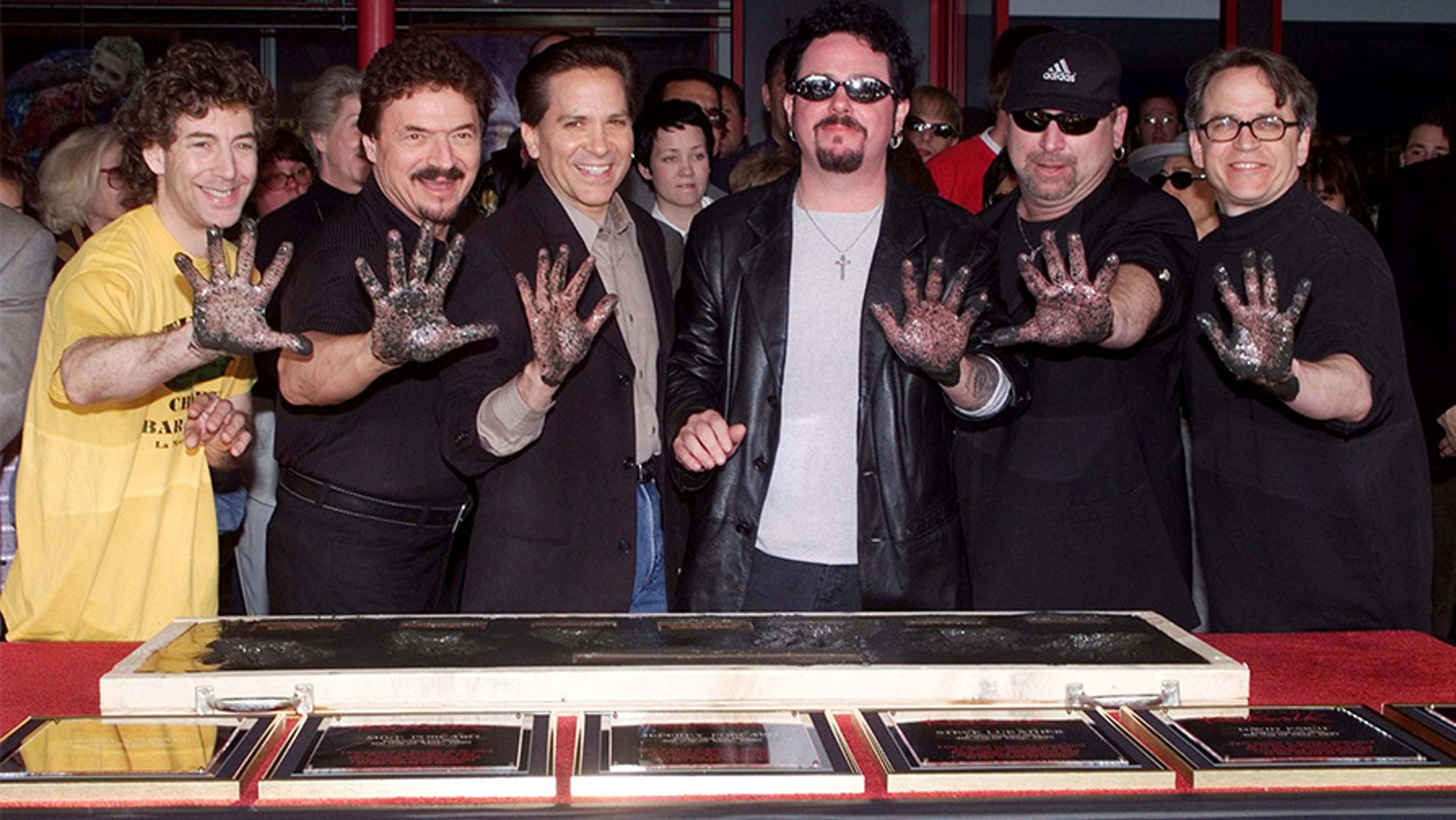"""Members of the rock band Toto pose after placing their handprints in cement as they were inducted into Hollywood's RockWalk May 4 in Hollywood. The band, best know for songs such as """"Rosanna"""" and """"Hold The Line"""" were honored for their contributions to the rock n' roll artform. Shown (L-R) are Simon Phillips, Bobby Kimball, Mike Porcaro, Steve Lukather, David Paich and Steve Porcaro.**DIGITAL IMAGE** - PBEAHULUKEG"""