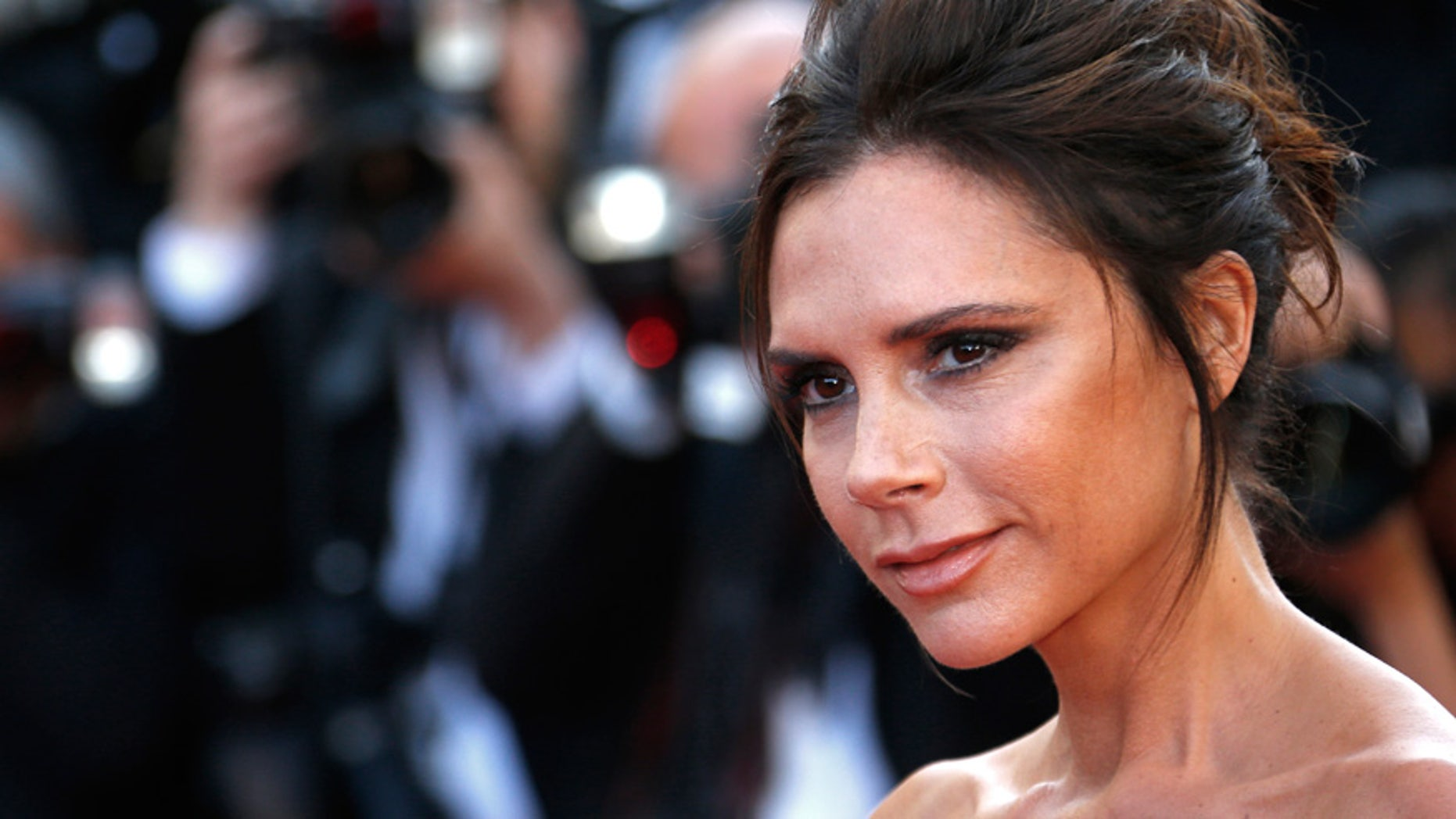 "Victoria Beckham poses on the red carpet as she arrives for the opening ceremony and the screening of the film ""Cafe Society"" out of competition during the 69th Cannes Film Festival in Cannes, France."