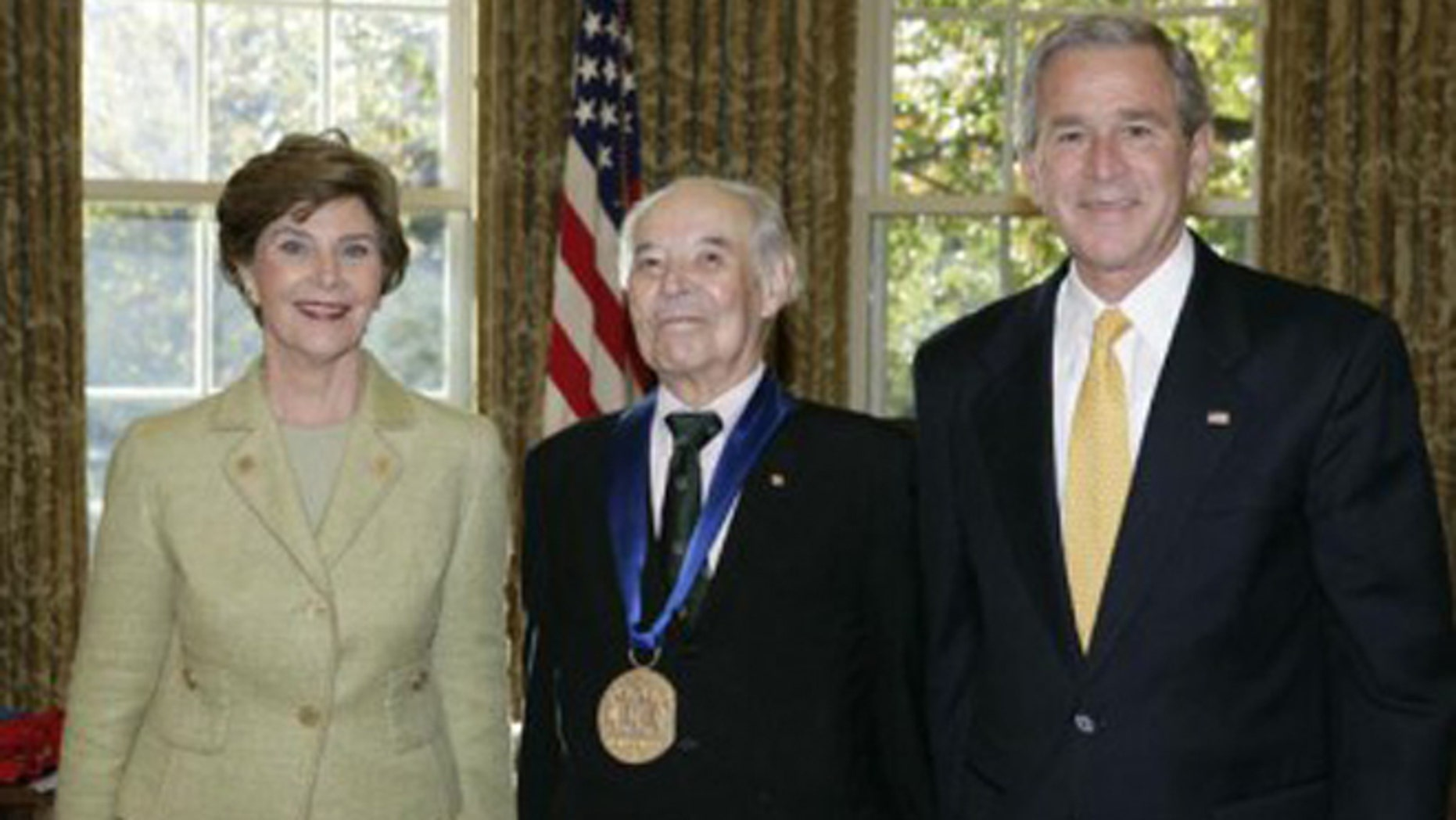 Gregory Rabassa with President George W. Bush and the First Lady, Laura Bush, receiving the 2006 National Medal of Arts.
