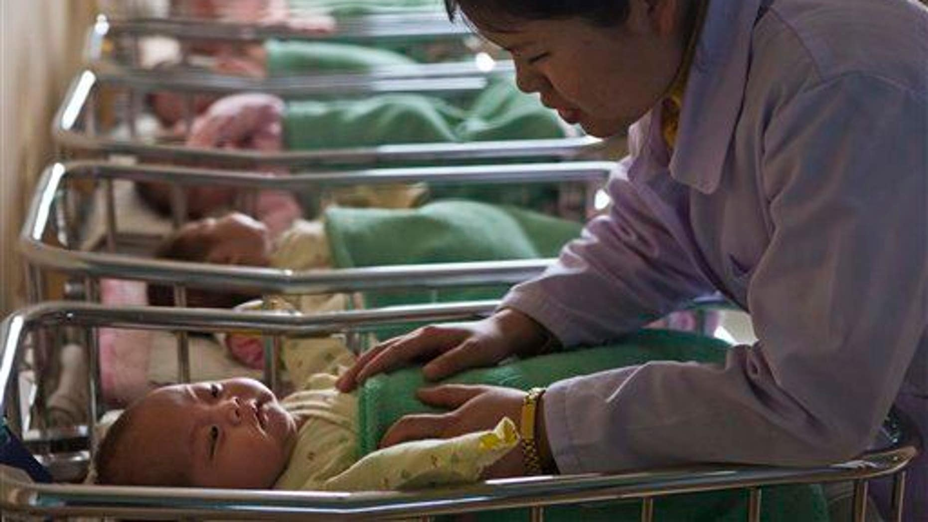 A baby boy born to a Chinese woman did not contract the rabies that killed his mother shortly after his birth.