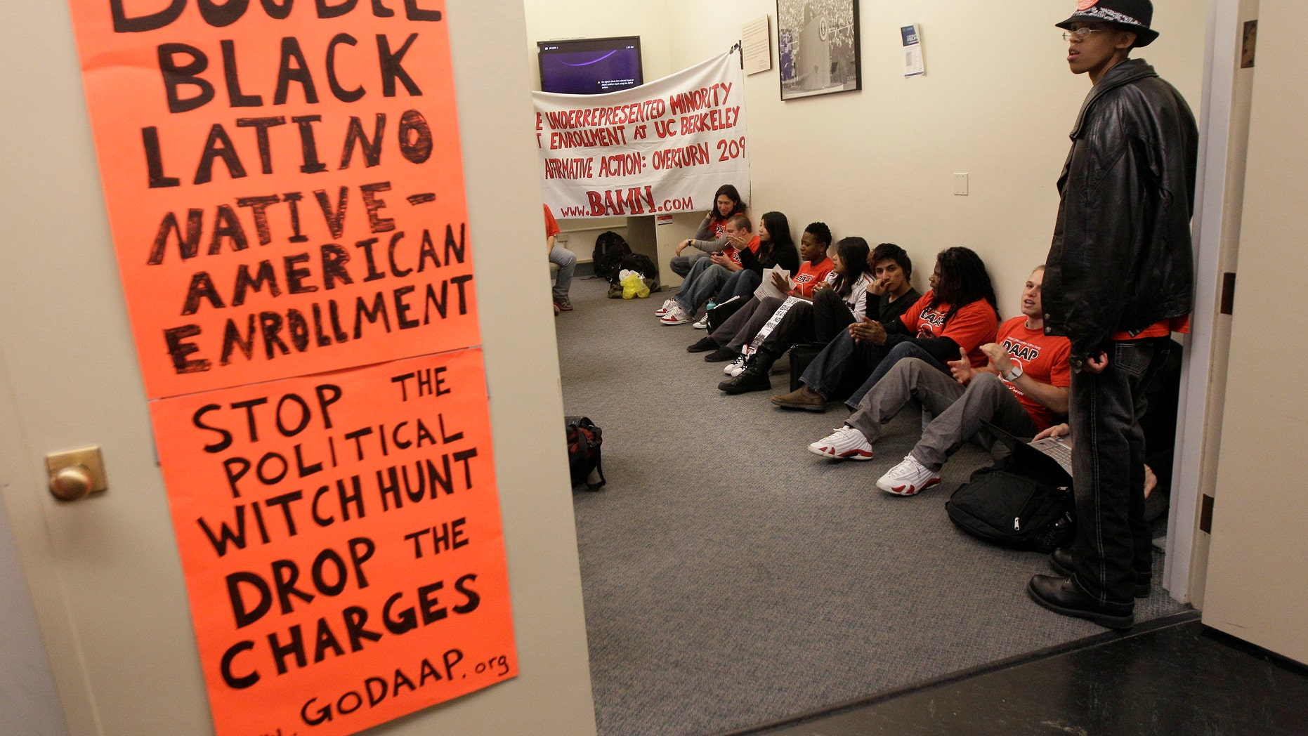 April 6, 2012: In this photo, protesters and students stage a sit in protest at the Sproul Hall Student Services Office at the University of California in Berkeley, Calif.