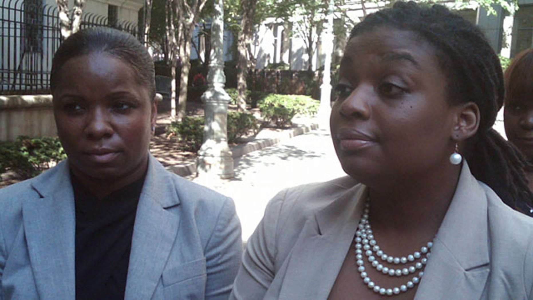 September 3, 2013: Brandi Johnson, left, and her lawyer, Marjorie M. Sharpe, leave federal court in New York after a civil jury awarded $30,000 in punitive damages in addition to the $250,000 in compensatory damages that had been awarded last week. The jury said STRIVE East Harlem, a nonprofit employment organization, must pay $5,000 while one of its founders, Rob Carmona, owes $25,000 in punitive damages after an audio-tape played during a week-long trial showed he launched an N-word laced tirade against Johnson while she worked at STRIVE last year. (AP Photo)