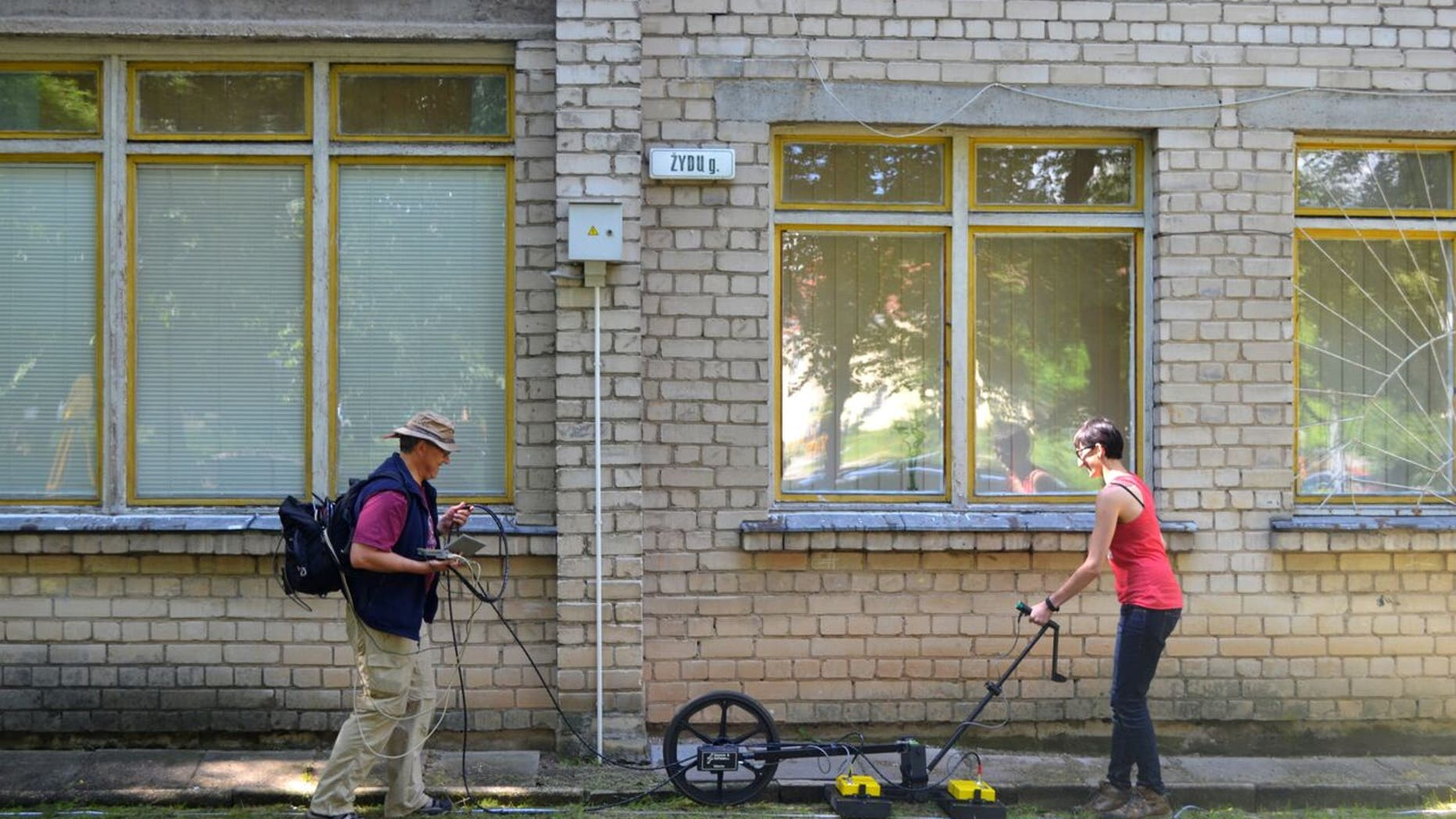 Prof. Harry Jol & Nicole Awad conducting a  Ground Penetrating Radar survey at the site of the Great Synagogue of Vilna in Lithuania.