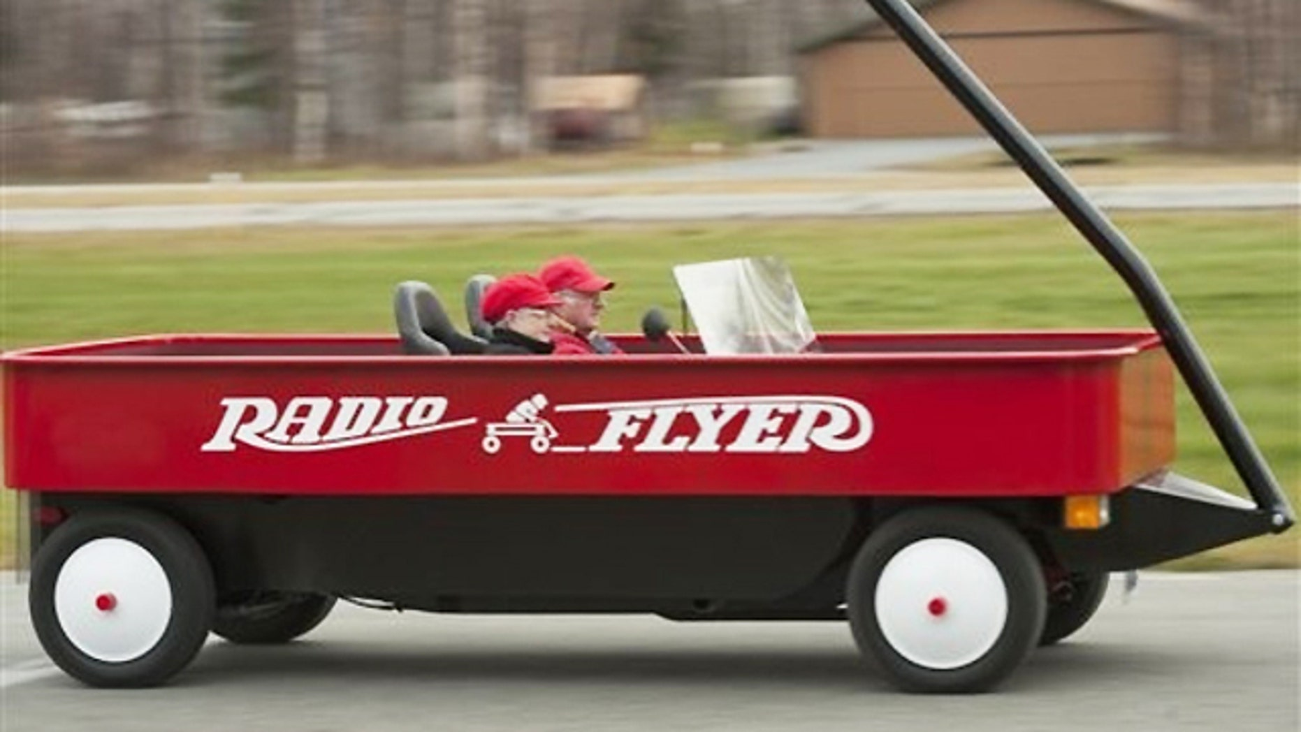 Fred Keller and Judy Foster worked on their oversized wagon for 11 months, using the base of a 1976 Mazda B1600 pickup truck.
