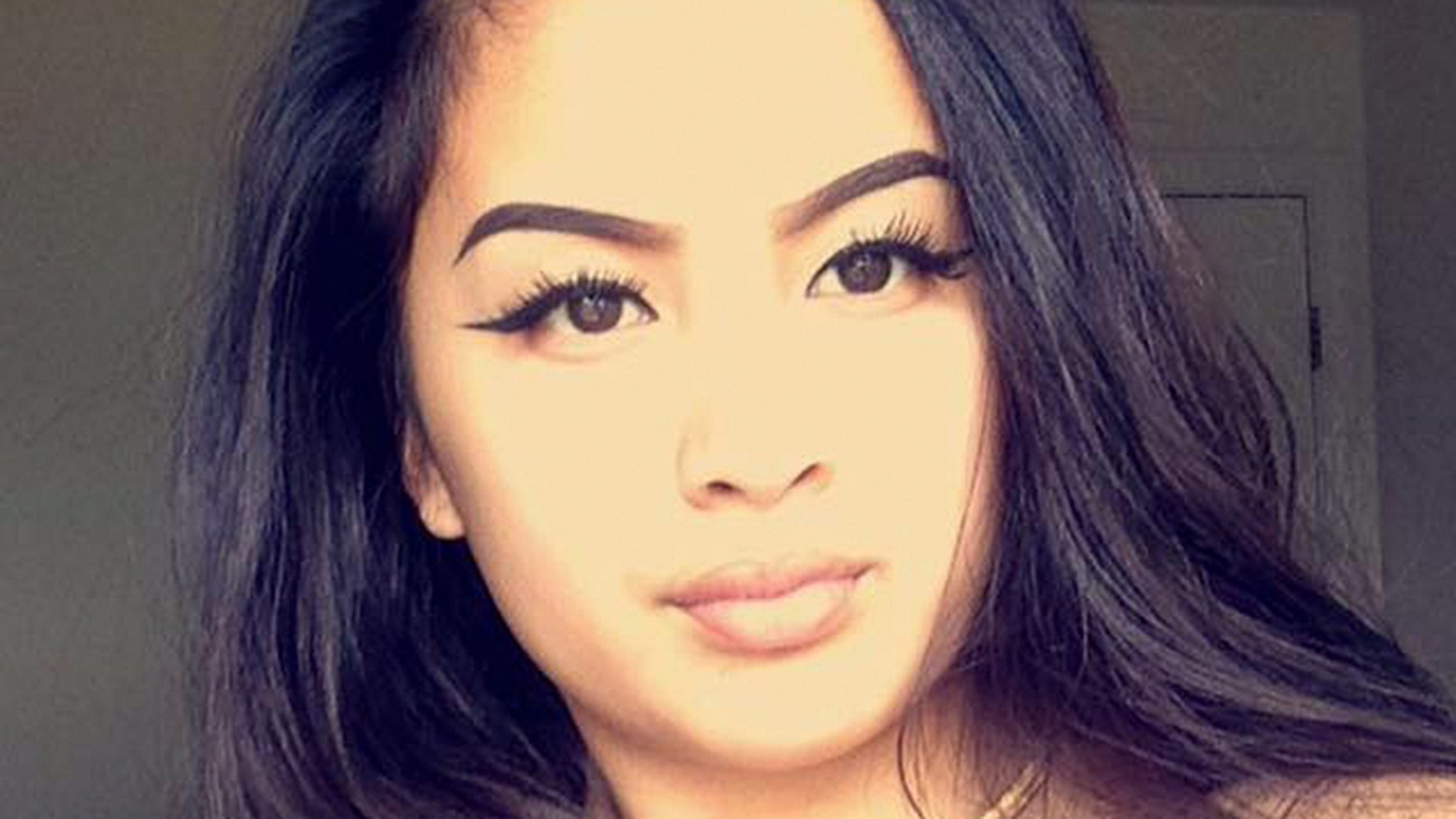 Raelyn Domingo was arrested in connection with a shooting and robbery.
