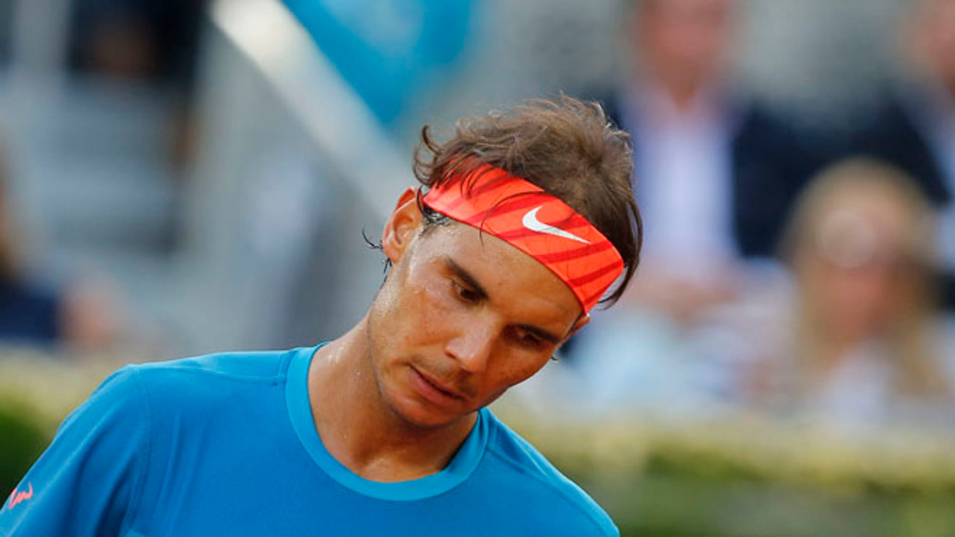 Rafael Nadal of Spain reacts during the men's singles final match against Andy Murray of Britain at the Madrid Open Tennis tournament in Madrid, Spain, Sunday, May 10, 2015. (AP Photo/Paul White)