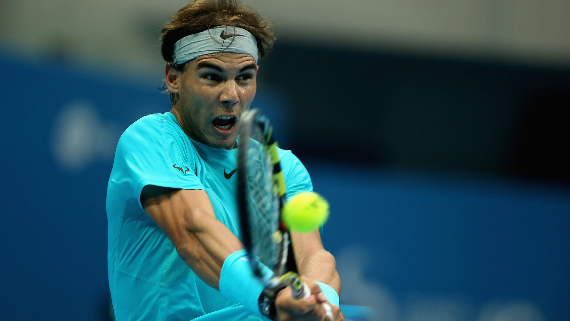 BEIJING, CHINA - OCTOBER 06:  Rafael Nadal of Spain returns a shot against Novak Djokovic of Serbia during the Men's Single Final  on night day of the China Open at the China National Tennis Center on October 6, 2013 in Beijing, China.  (Photo by Feng Li/Getty Images)