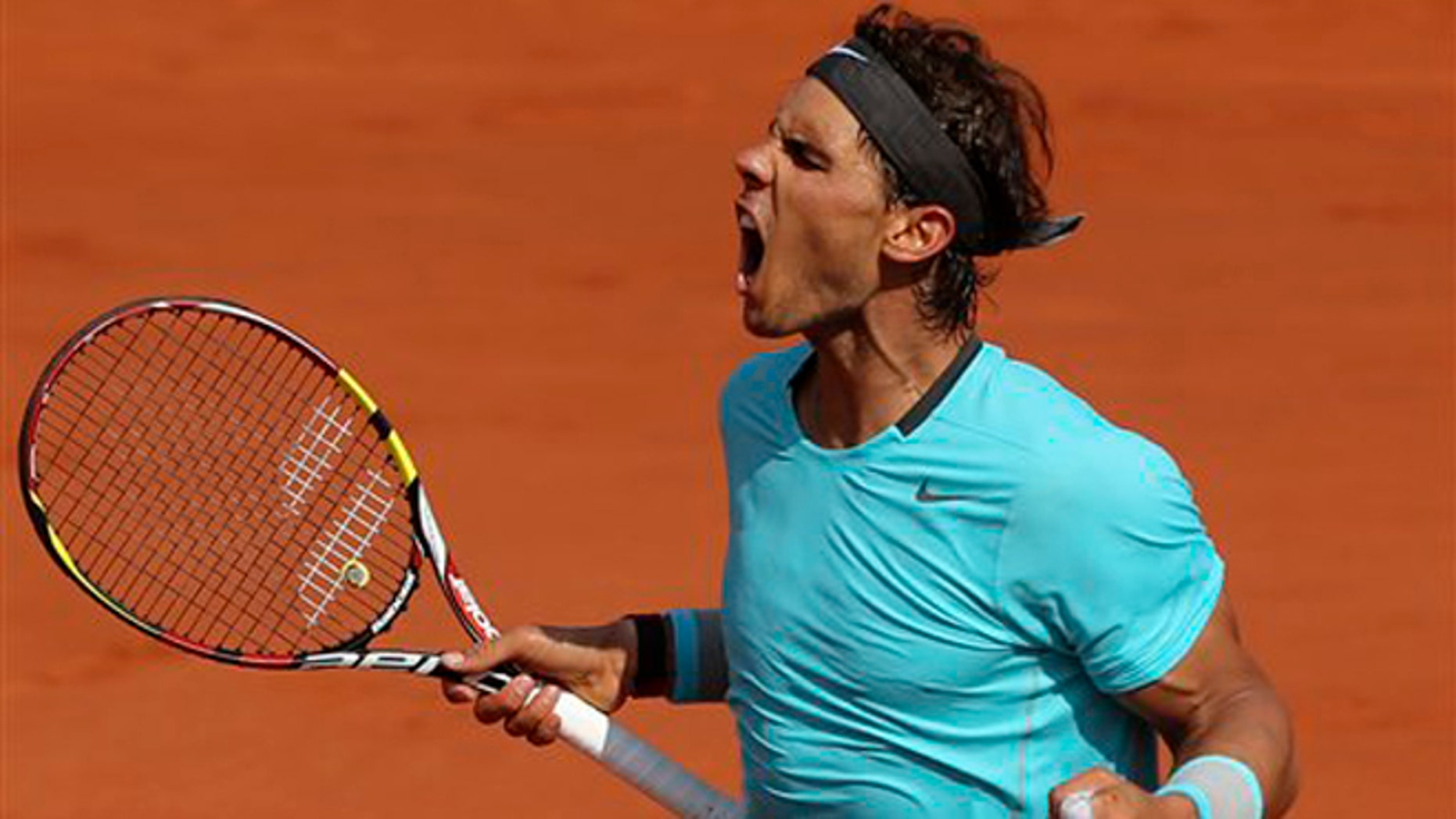 Spain's Rafael Nadal reacts as he wins  the second set against Serbia's Novak Djokovic during their final match of  the French Open tennis tournament at the Roland Garros stadium, in Paris, France, Sunday, June 8, 2014. (AP Photo/Thibault Camus)