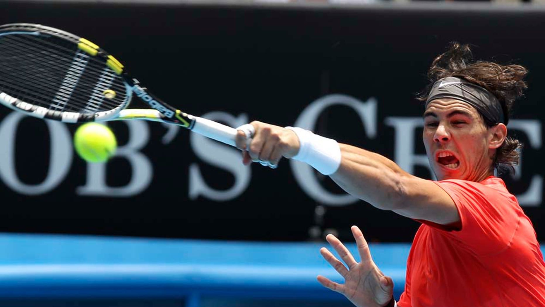 during their first round match at the Australian Open tennis championships in Melbourne, Australia, Tuesday, Jan. 18, 2011.   (AP Photo/Mark Baker)