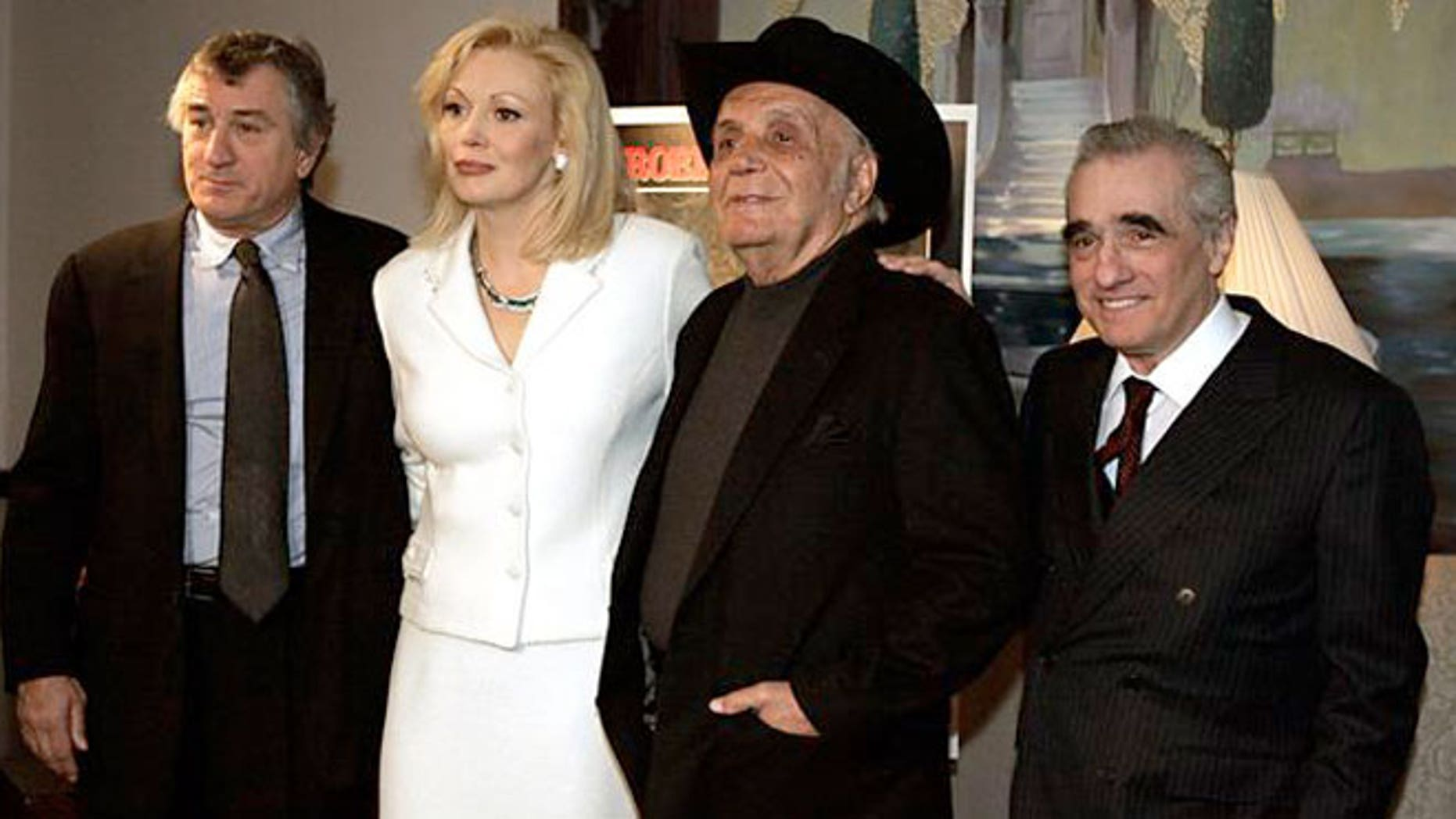 "Robert De Niro, Cathy Moriarty, Jake LaMotta, and Martin Scorsese, (l-r), pose together in New York. MGM is suing LaMotta over his attempts to make a ""Raging Bull"" sequel."